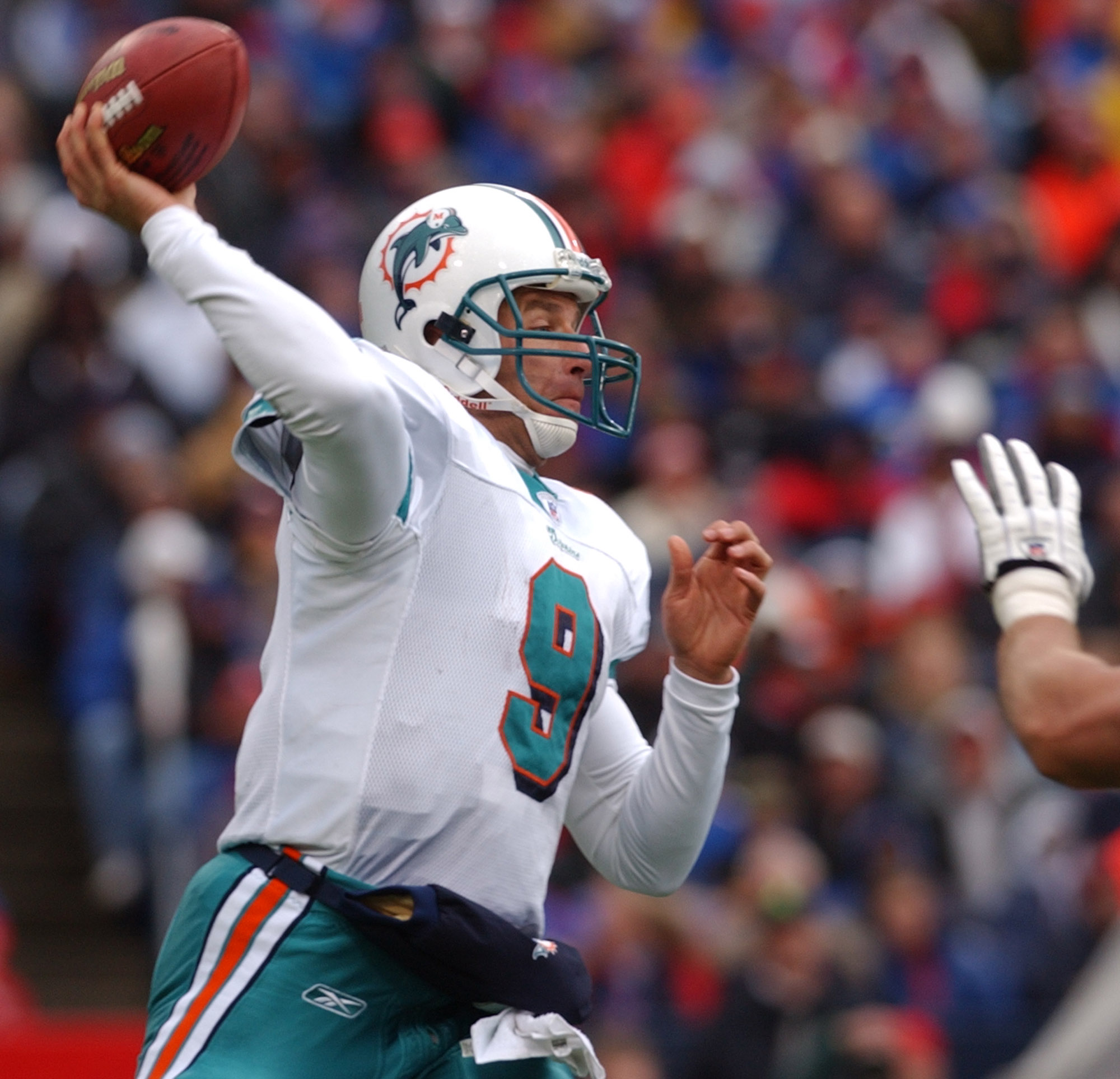 FILE - In this Oct. 17, 2004, file photo, Miami Dolphins quarterback Jay Fiedler passes during the second half against the Buffalo Bills in Orchard Park, N.Y. Dan Marino, perhaps the game's greatest pure passer, left Miami in 1999. In stepped Fiedler who