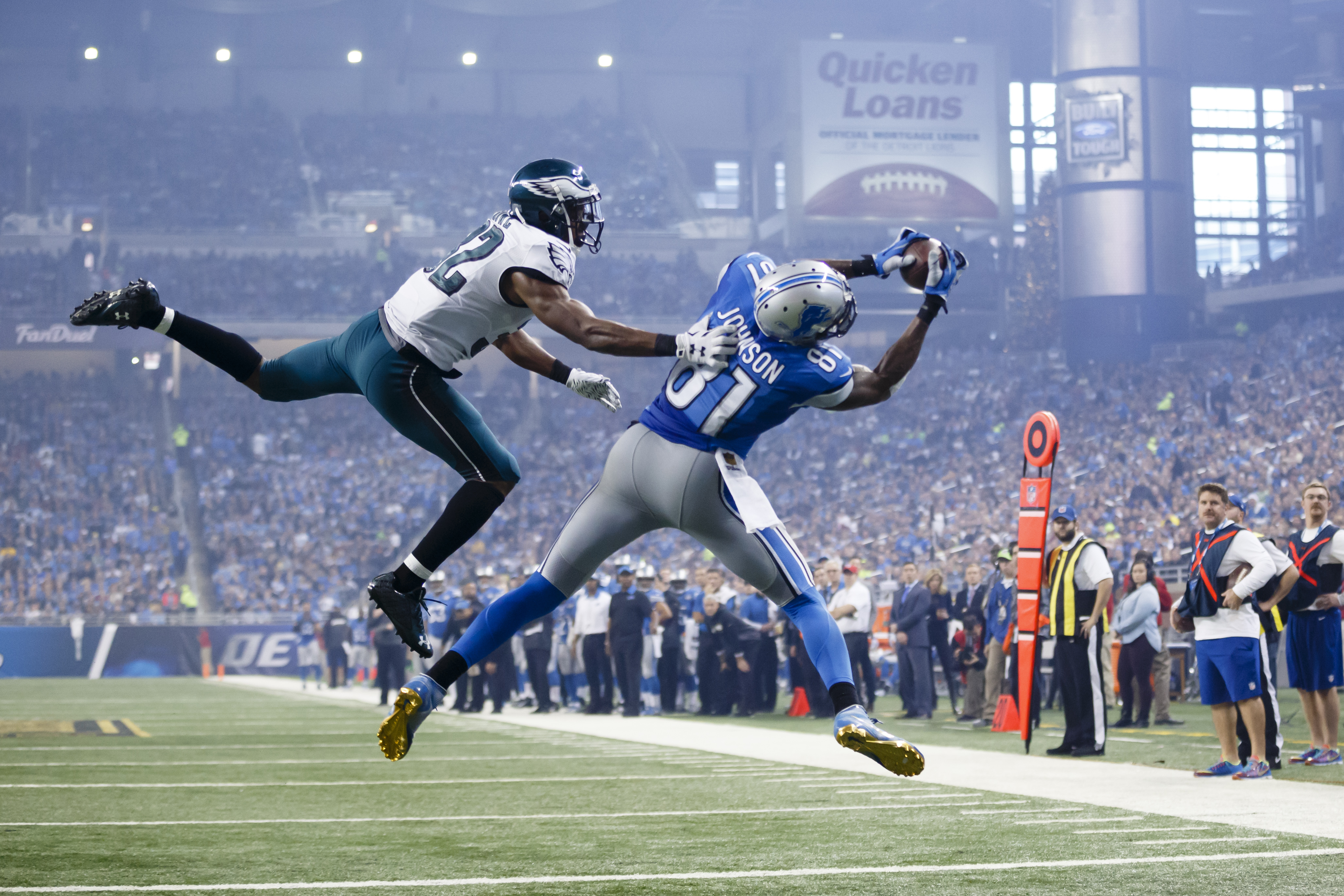 FILE - In this Nov. 26, 2015, file photo, Detroit Lions wide receiver Calvin Johnson (81), defended by Philadelphia Eagles cornerback Eric Rowe (32) , catches a pass for a touchdown during the second half of an NFL football game, in Detroit. Calvin Johnso