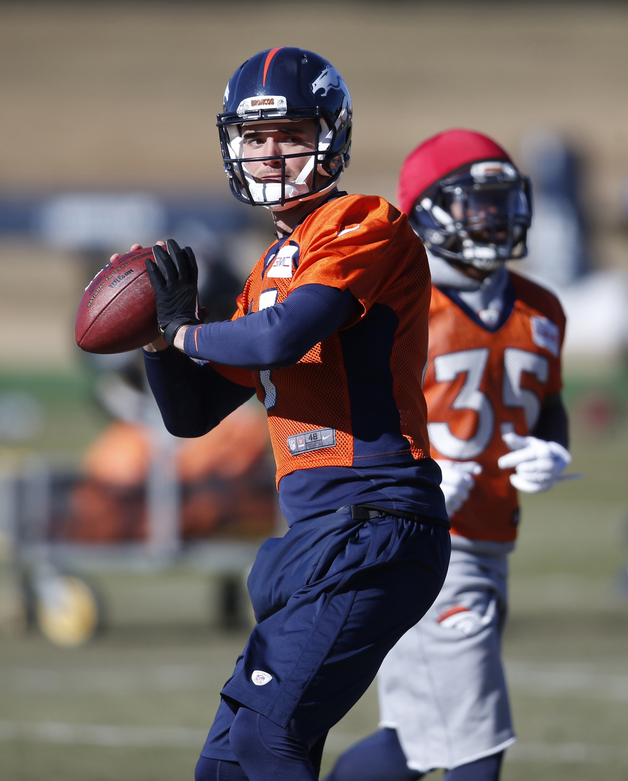 FILE - In this Jan. 21, 2016, file photo, Denver Broncos quarterback Brock Osweiler passes during an NFL football practice at the team's headquarters in Englewood, Colo. Now that the Broncos have bid their farewells to quarterback Peyton Manning, who reti