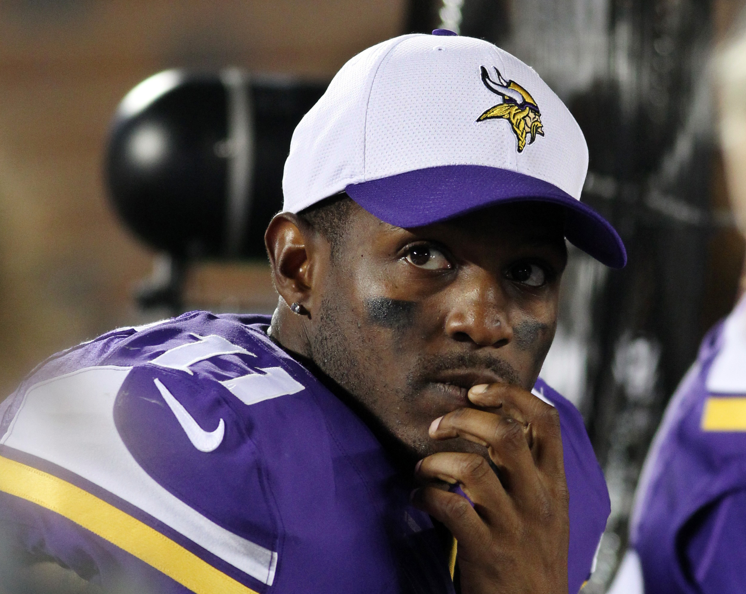 FILE - In this Aug. 22, 2015, file phot , Minnesota Vikings wide receiver Mike Wallace sits on the bench during the second half of a preseason NFL football game against the Oakland Raiders in Minneapolis. The Vikings released Wallace on Tuesday, March 8,