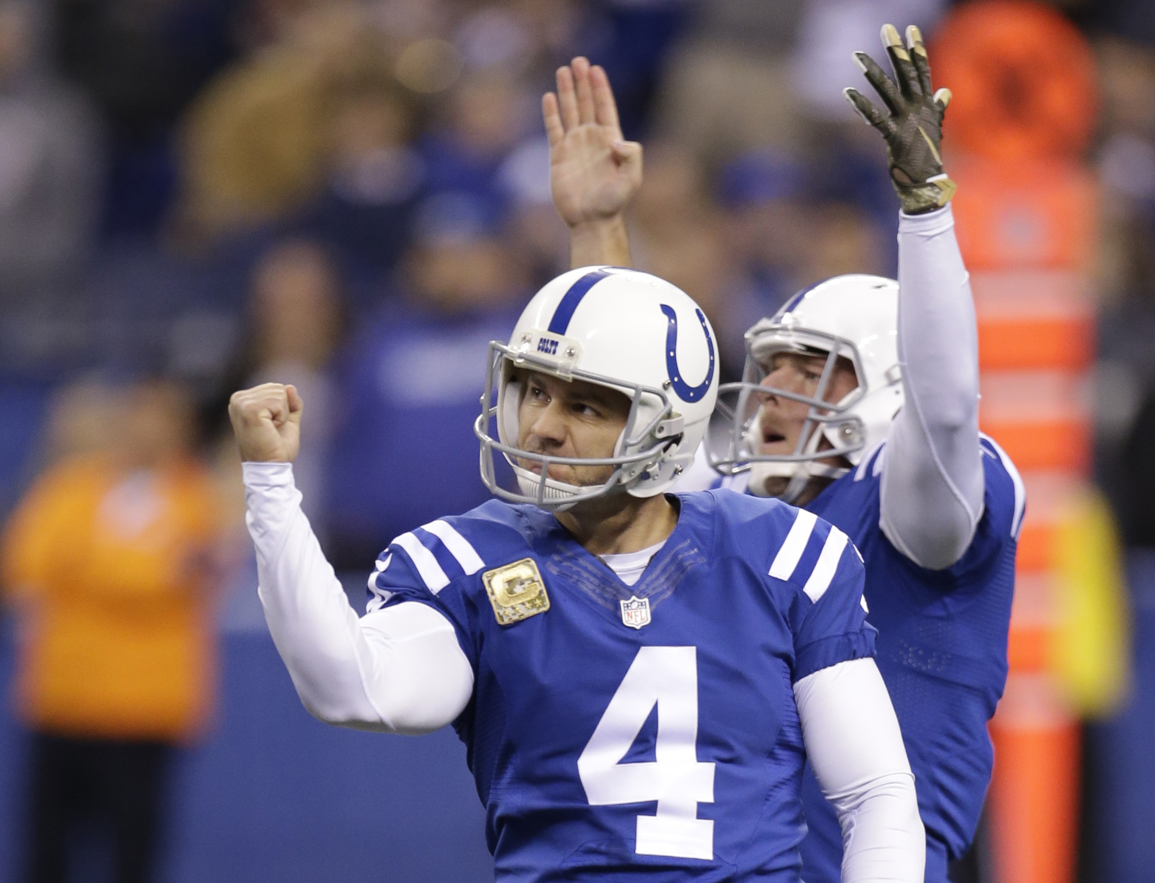 FILE - In this Nov. 8, 2015, file photo, Indianapolis Colts' Adam Vinatieri (4) celebrates with Pat McAfee after Vinatieri kicked a 55-yard field goal during an NFL football game against the Denver Broncos in Indianapolis. Vinatieri, the NFL's oldest play