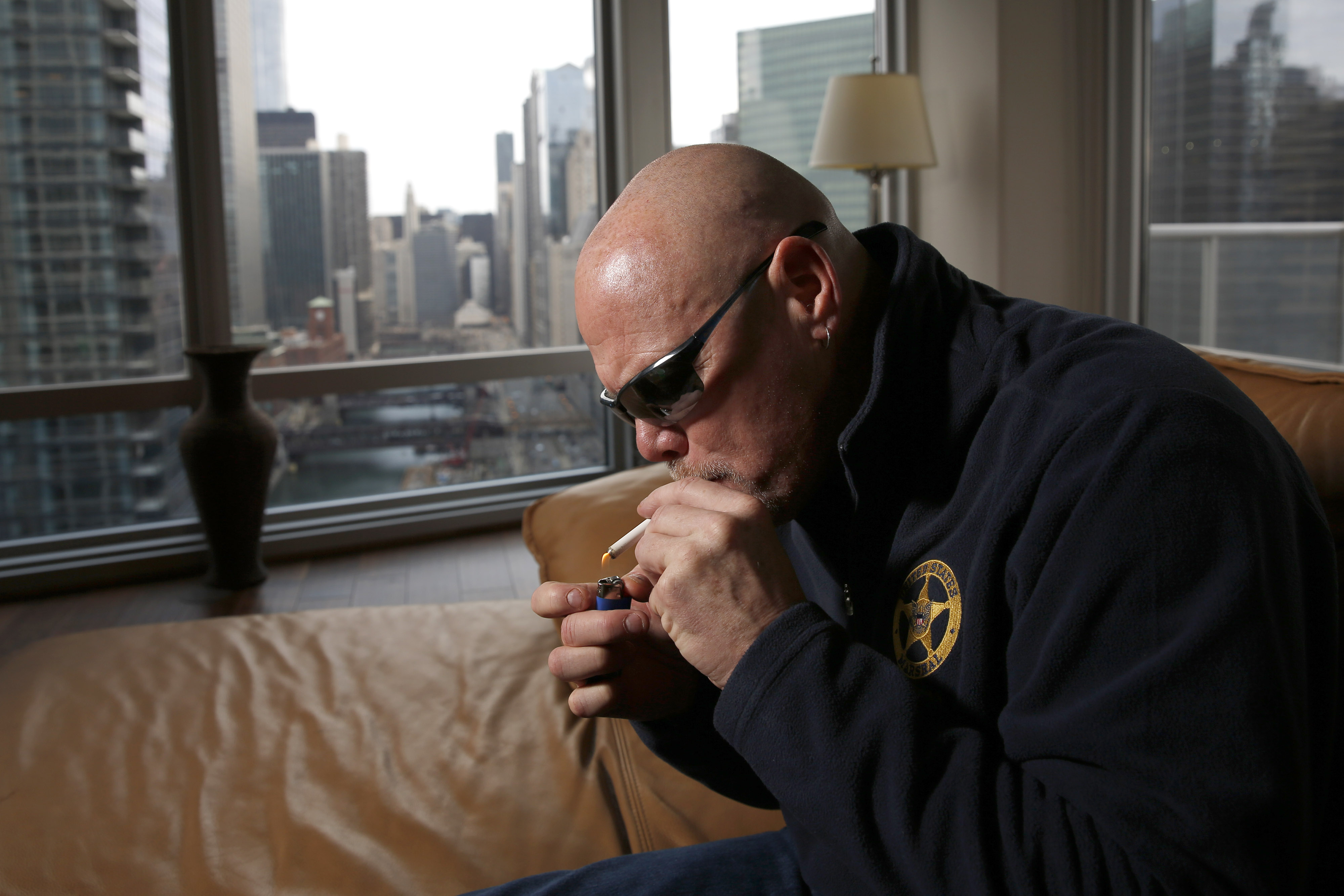 """In this Jan. 28, 2016 photo, former Chicago Bears quarterback Jim McMahons smokes medical marijuana in Chicago. McMahon calls himself """"old school,"""" including his use of marijuana both during and after his career. Yet McMahon's stab at self-medicating coul"""