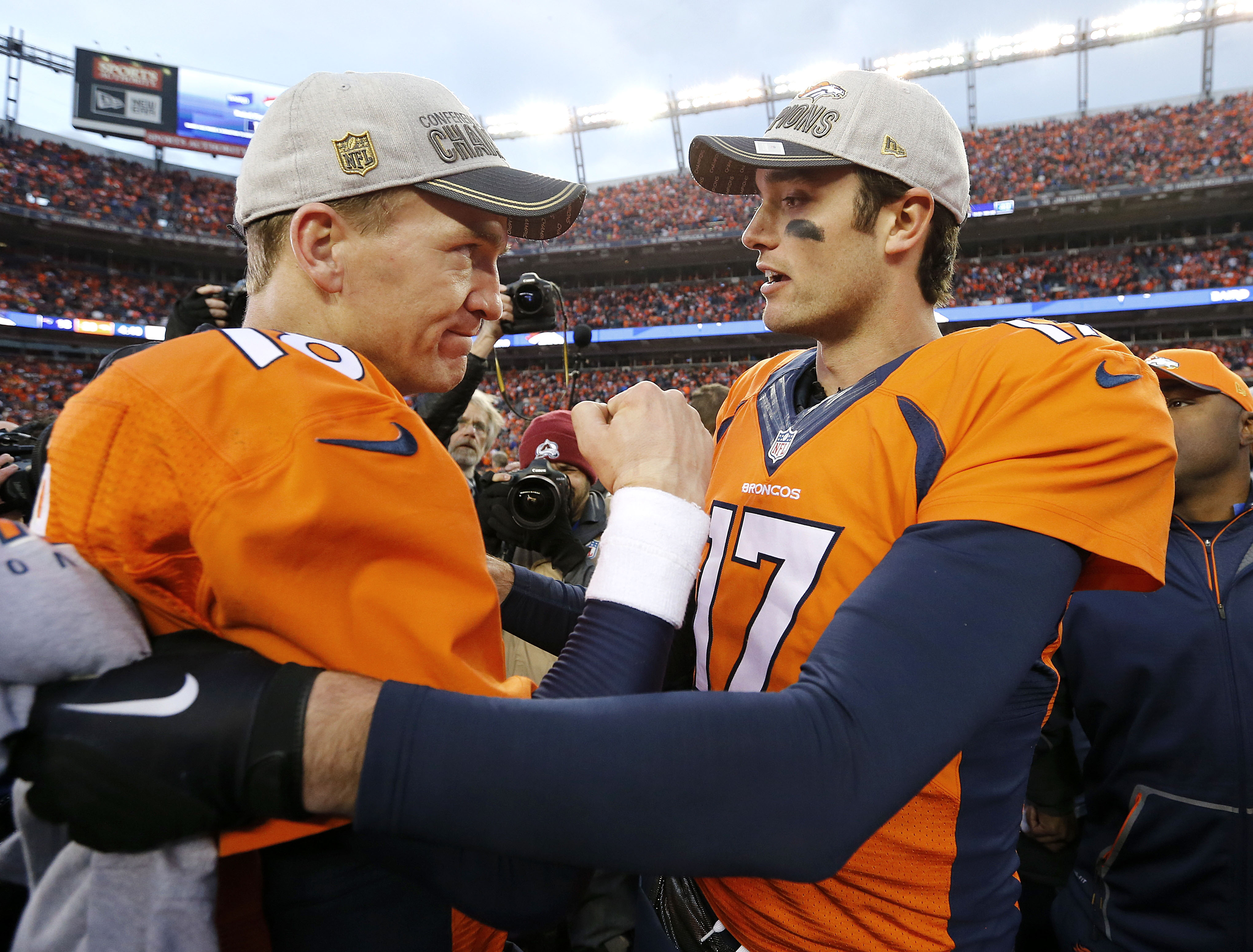 FILE - In this Jan. 24, 2016, file photo, Denver Broncos quarterback Peyton Manning, left, is congratulated by quarterback Brock Osweiler following their  20-18 win over the New England Patriots in the AFC championship  NFL football game in Denver. With P