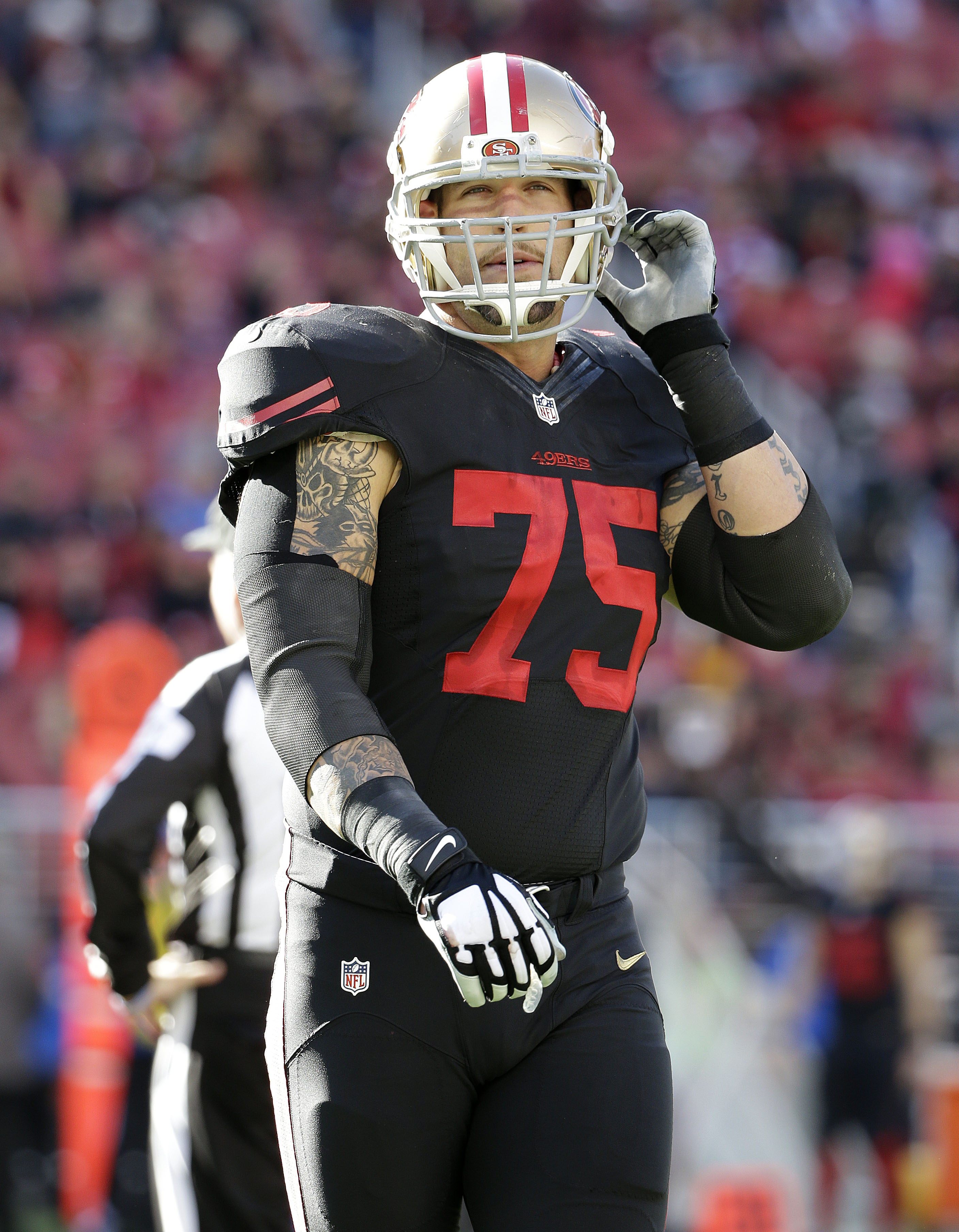 FILE - In this Nov. 29, 2015, file photo, San Francisco 49ers offensive tackle Alex Boone adjusts his helmet strap during the first half of an NFL football game against the Arizona Cardinals in Santa Clara, Calif. A person with direct knowledge of the dea
