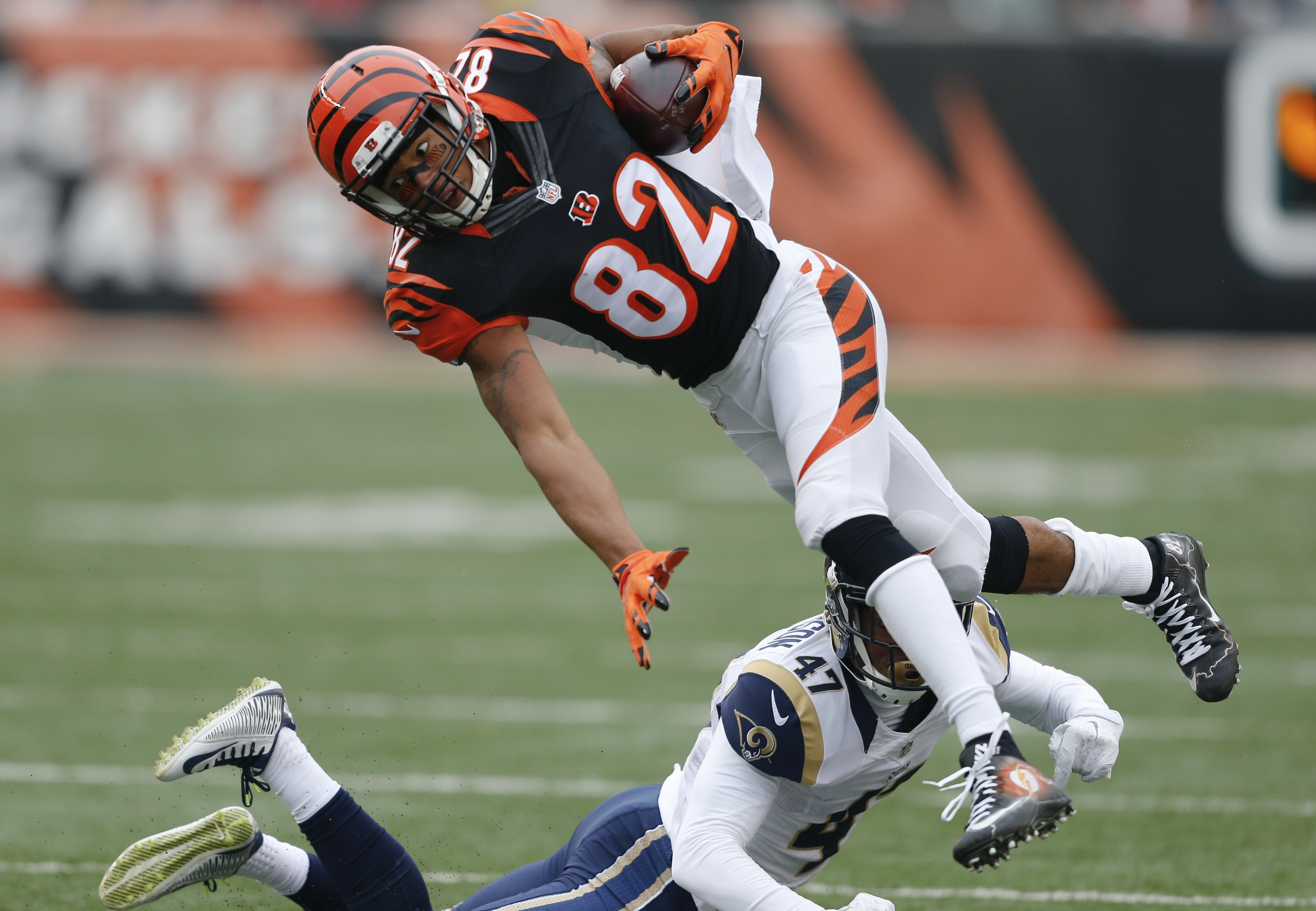 FILE - In this Nov. 29, 2015, file photo, Cincinnati Bengals wide receiver Marvin Jones (82) leaps over St. Louis Rams cornerback Marcus Roberson (47) in the first half of an NFL football game, in Cincinnati. The Detroit Lions have agreed to a five-year c