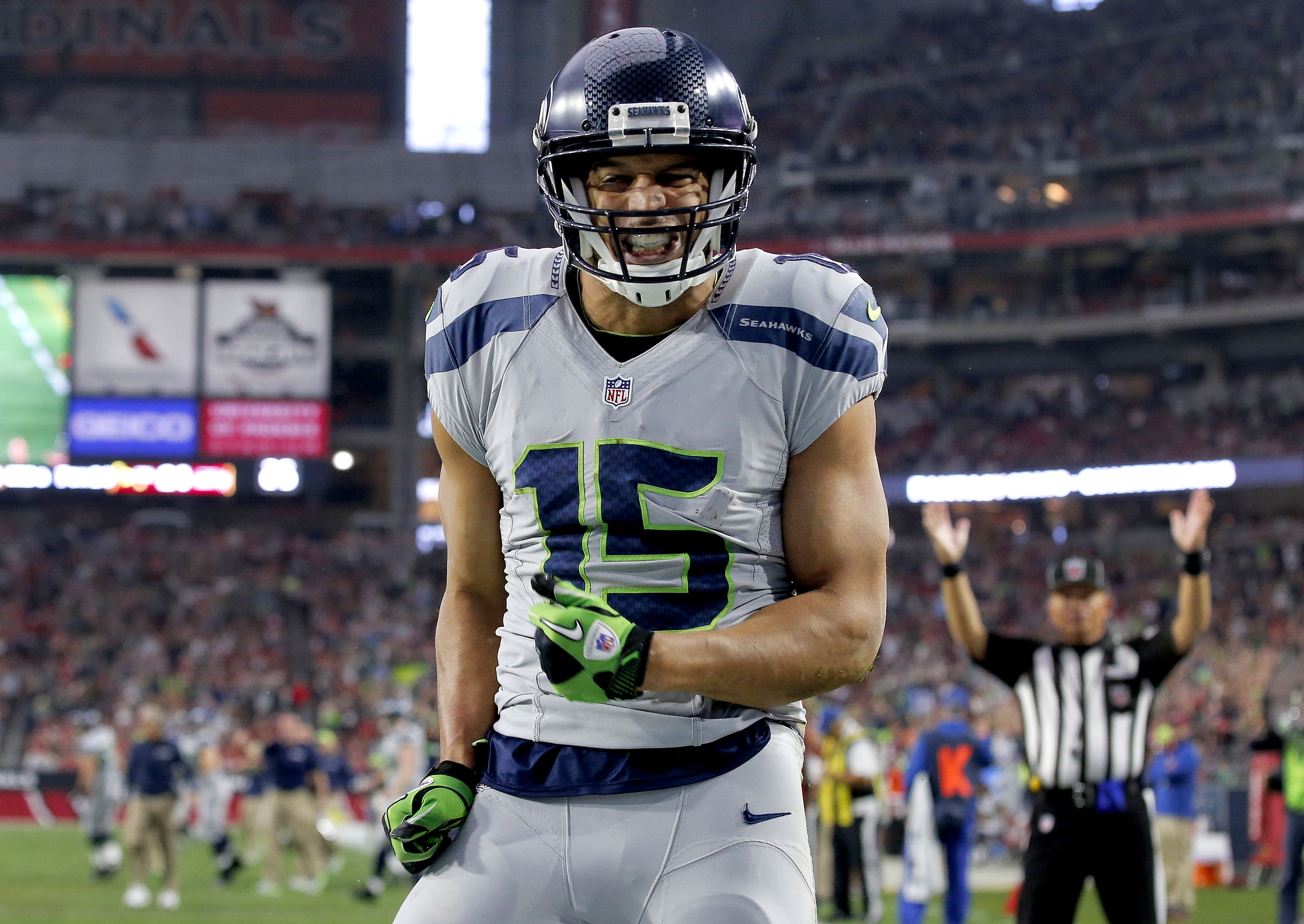 Seattle Seahawks wide receiver Jermaine Kearse (15) celebrates his touchdown against the Arizona Cardinals during the first half of an NFL football game, Sunday, Jan. 3, 2016, in Glendale, Ariz. (AP Photo/Ross D. Franklin)