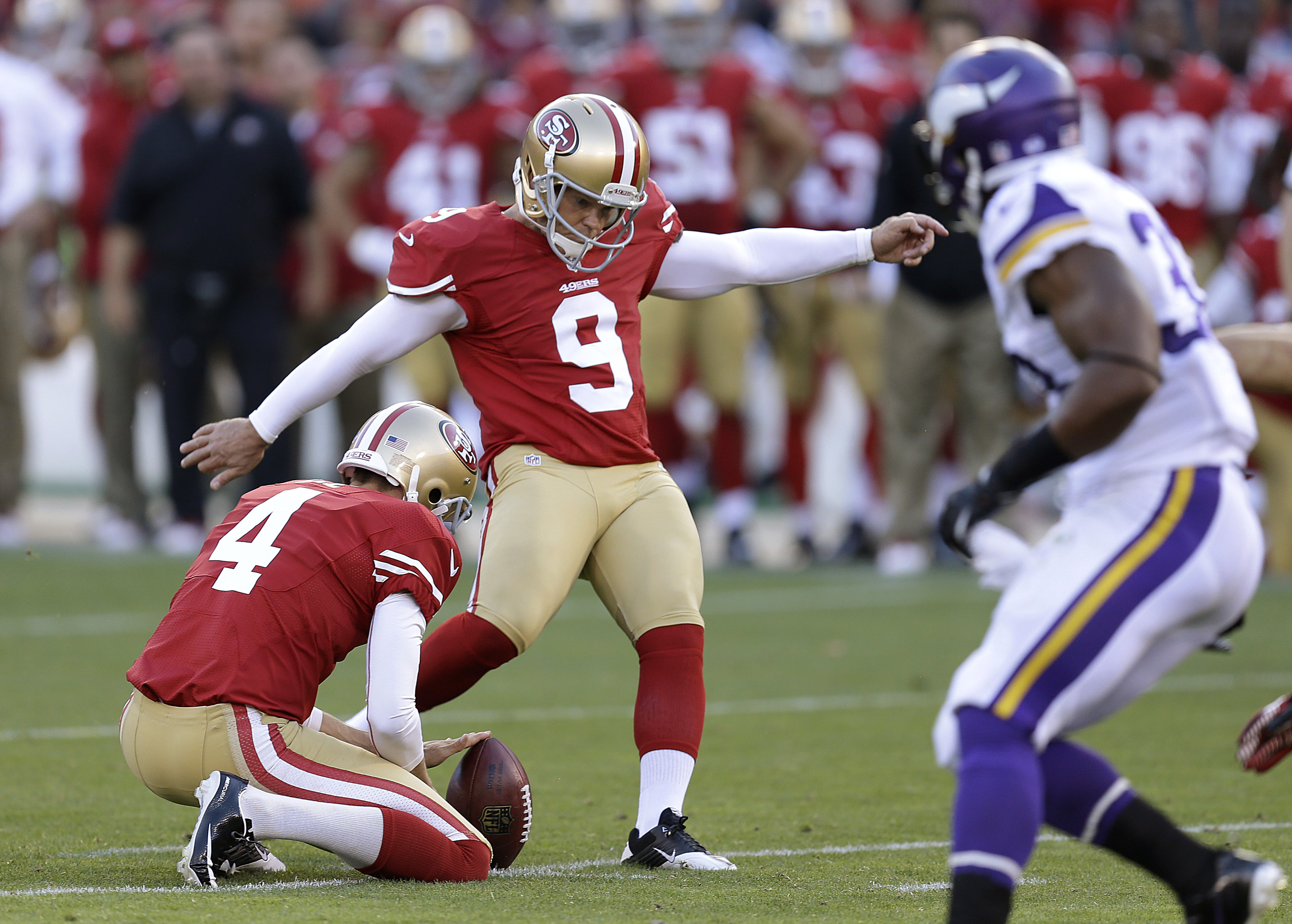 FILE - In this Aug. 25, 2013, file photo, San Francisco 49ers' Phil Dawson (9) kicks a field goal from the hold of punter Andy Lee (4) during an NFL preseason football game against the Minnesota Vikings in San Francisco. Veteran kicker Dawson reached agre