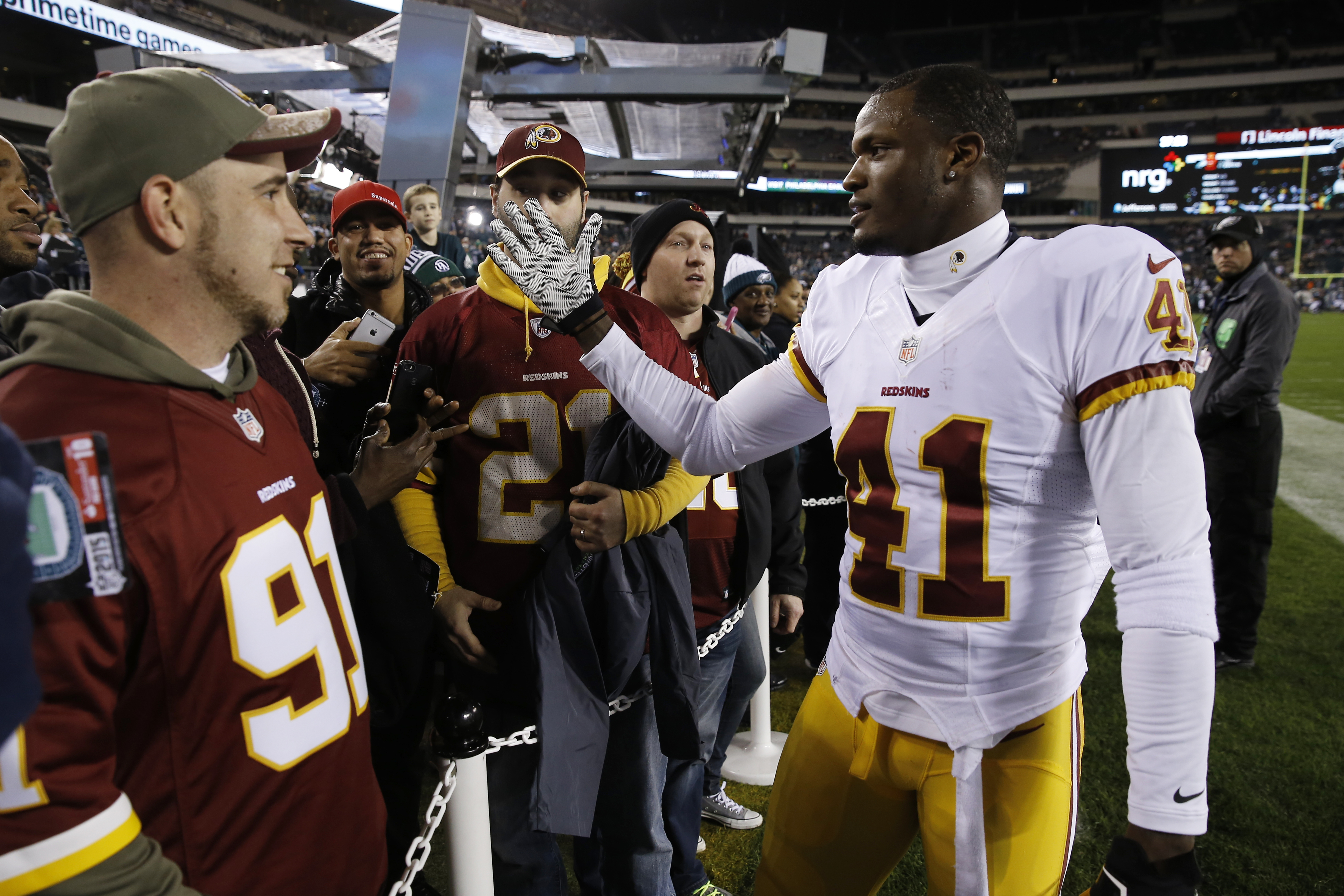 FILE - In this Dec. 26, 2015, file photo, Washington Redskins' Will Blackmon meets fans before an NFL football game against the Philadelphia Eagles, in Philadelphia. Blackmon's agent says the cornerback has re-signed with the Redskins on a two-year deal.