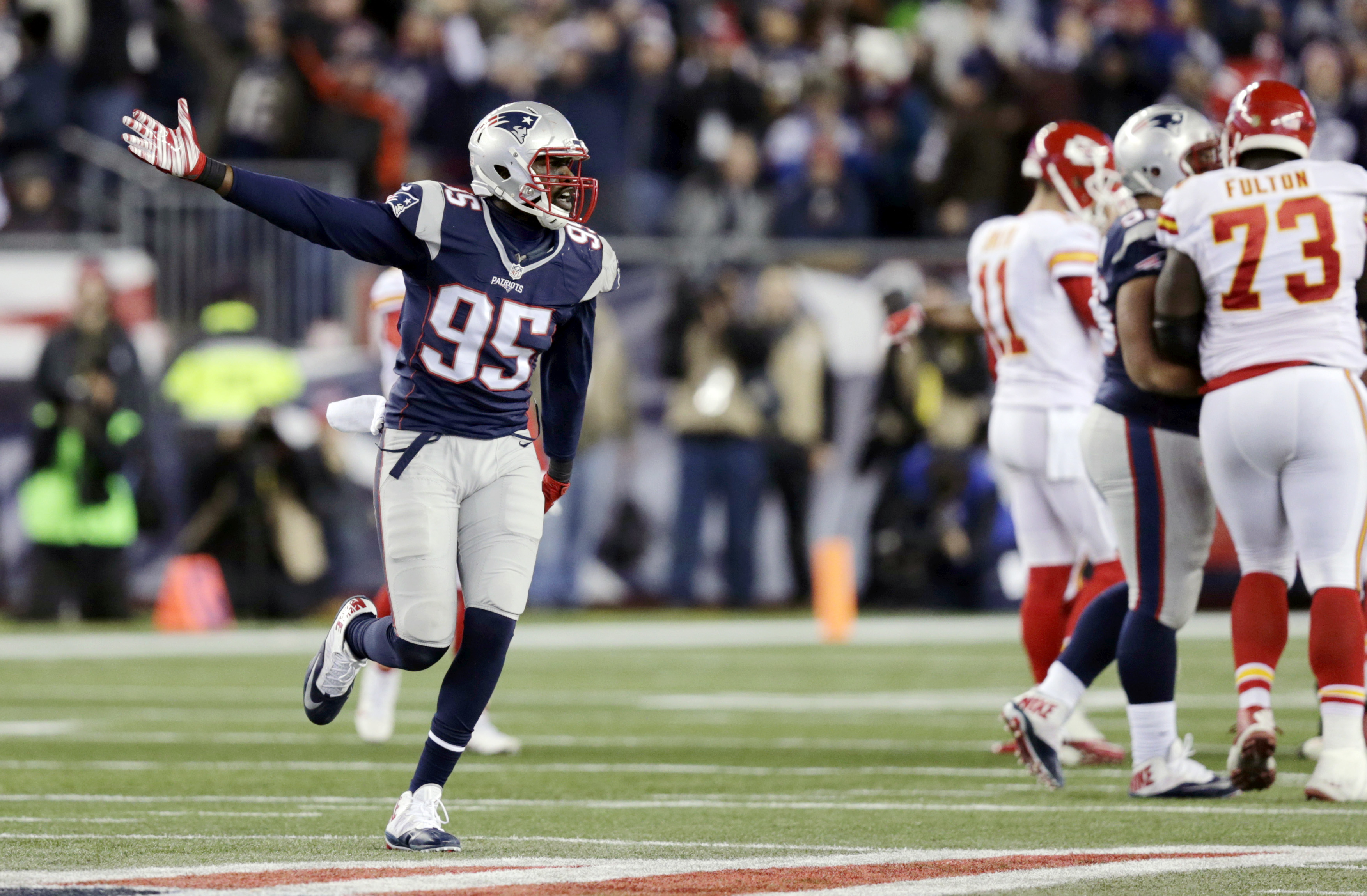 New England Patriots defensive end Chandler Jones (95) celebrates after his team recovered a fumble by the Kansas City Chiefs in the second half of an NFL divisional playoff football game, Saturday, Jan. 16, 2016, in Foxborough, Mass. (AP Photo/Charles Kr