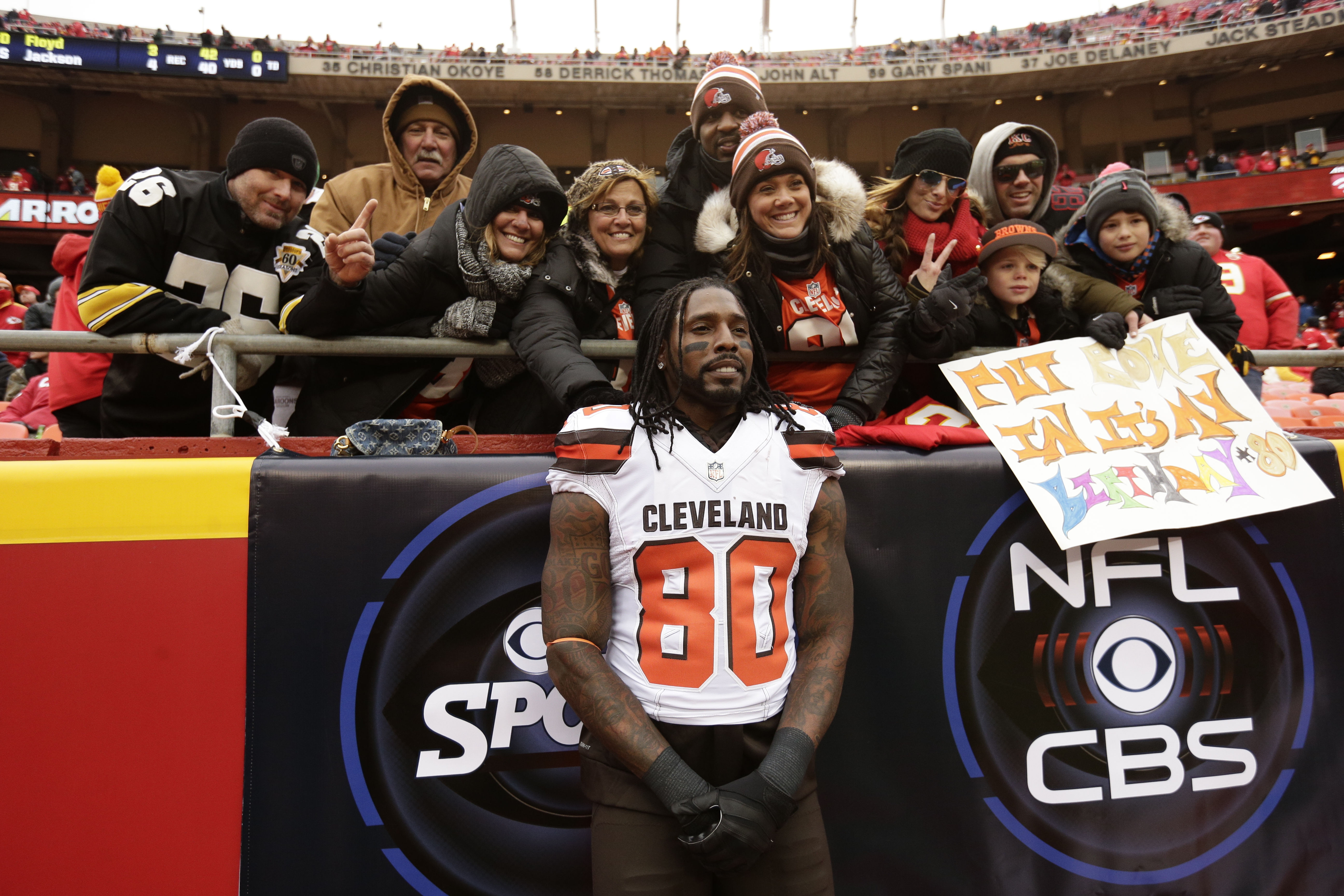 Cleveland Browns wide receiver Dwayne Bowe (80), a former Chiefs player, takes a photo with fans before an NFL football game against the Kansas City Chiefs in Kansas City, Mo., Sunday, Dec. 27, 2015. (AP Photo/Charlie Riedel)