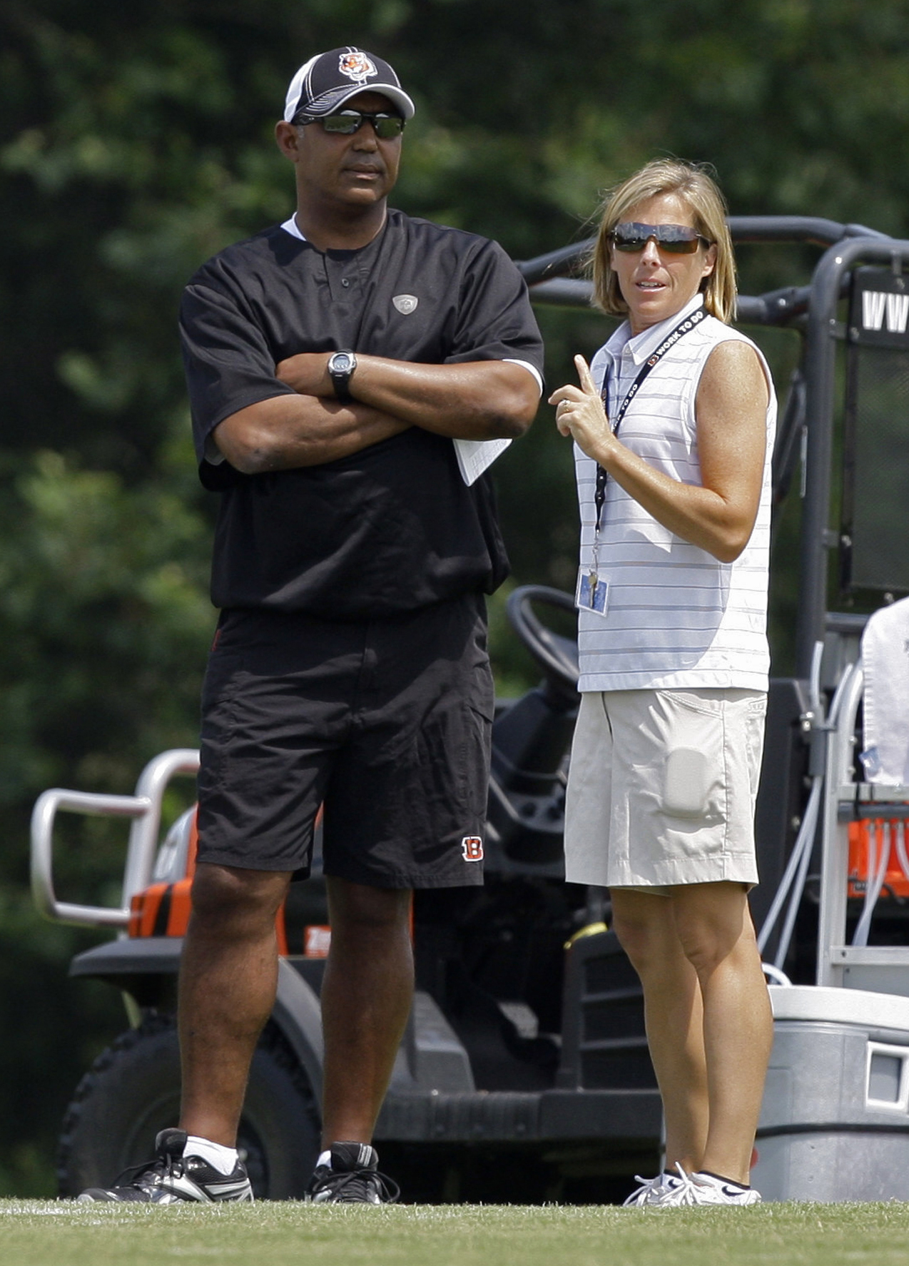 FILE - In this Aug. 1, 2010 file photo, Cincinnati Bengals executive vice president Katie Blackburn, right, talks with head coach Marvin Lewis during practice at the NFL football team's training camp in Georgetown, Ky. Blackburn is the daughter of Bengals
