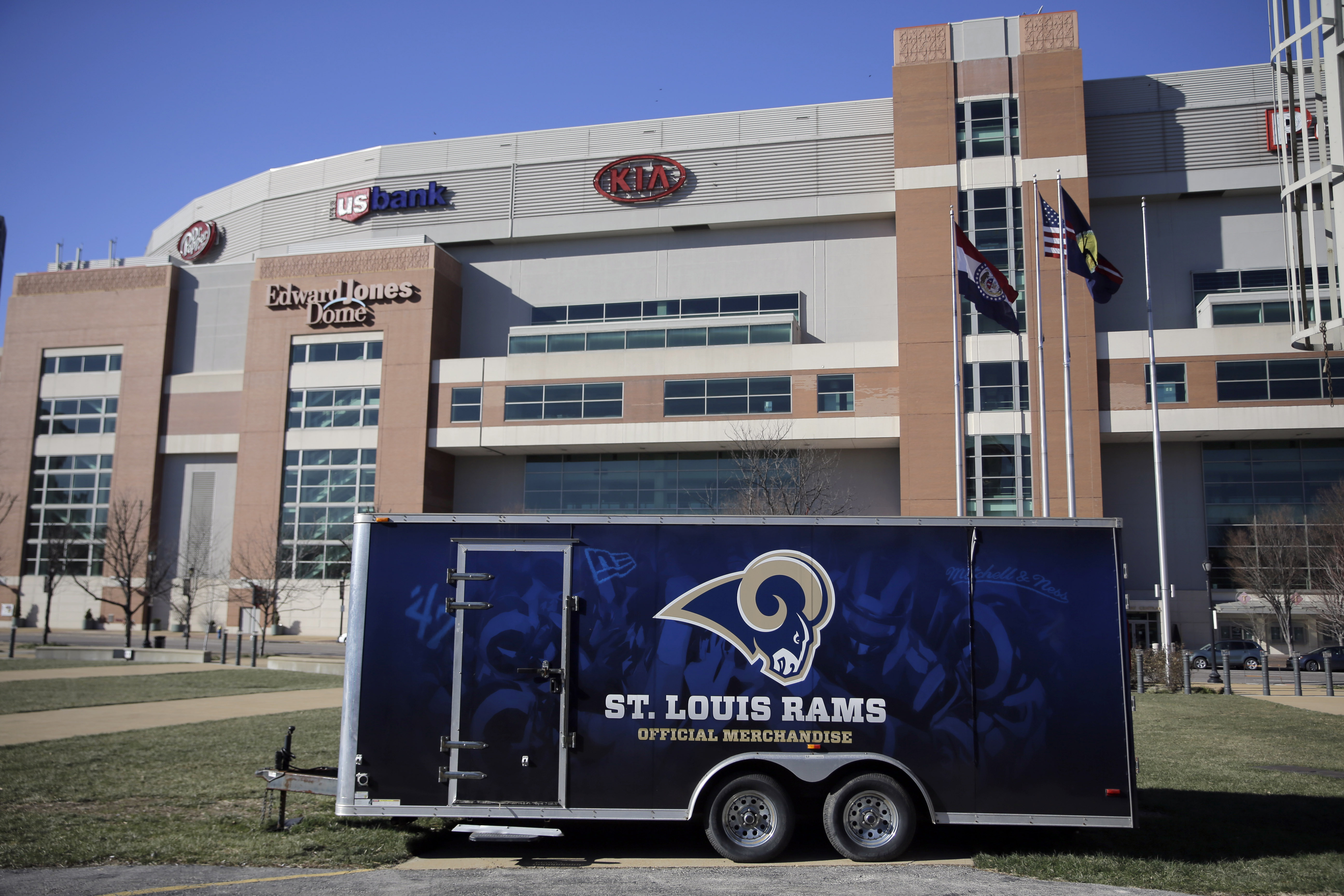 File-This Jan. 13, 2016, file photo shows a merchandise trailer sitting outside the Edward Jones Dome, former home of the St. Louis Rams, in St. Louis. For weeks now, a steady succession of moving vans has been hauling away whatever the Los Angeles Rams w