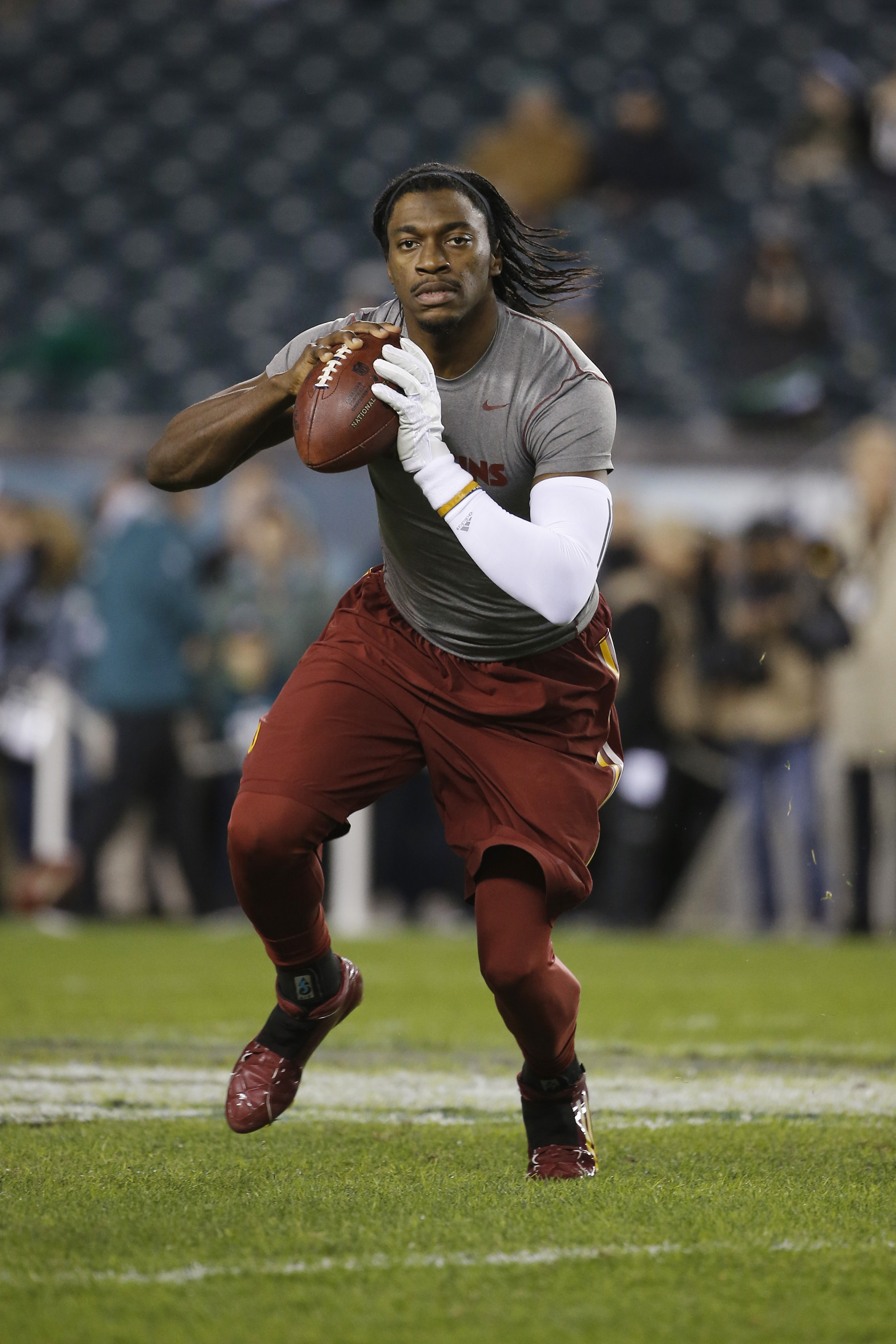 FILE - In this Dec. 26, 2015, file photo, Washington Redskins' Robert Griffin III warms up before an NFL football game against the Philadelphia Eagles, in Philadelphia. Cleveland's never-ending search for a franchise quarterback could come down to a compe