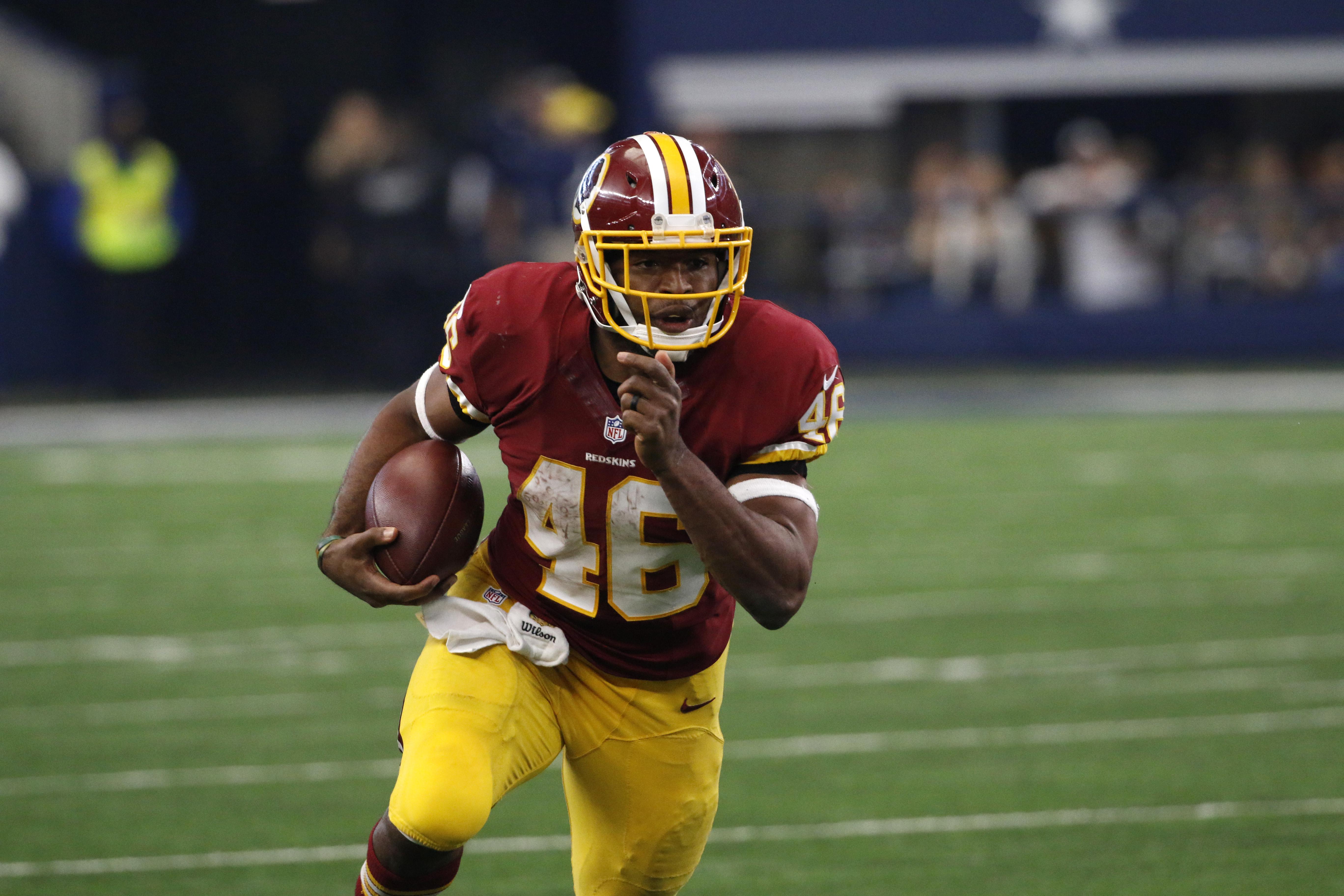 Washington Redskins running back Alfred Morris (46) runs the ball against the Dallas Cowboys during an NFL football game, Sunday, Jan. 3, 2016, in Arlington, Texas. (AP Photo/Roger Steinman)