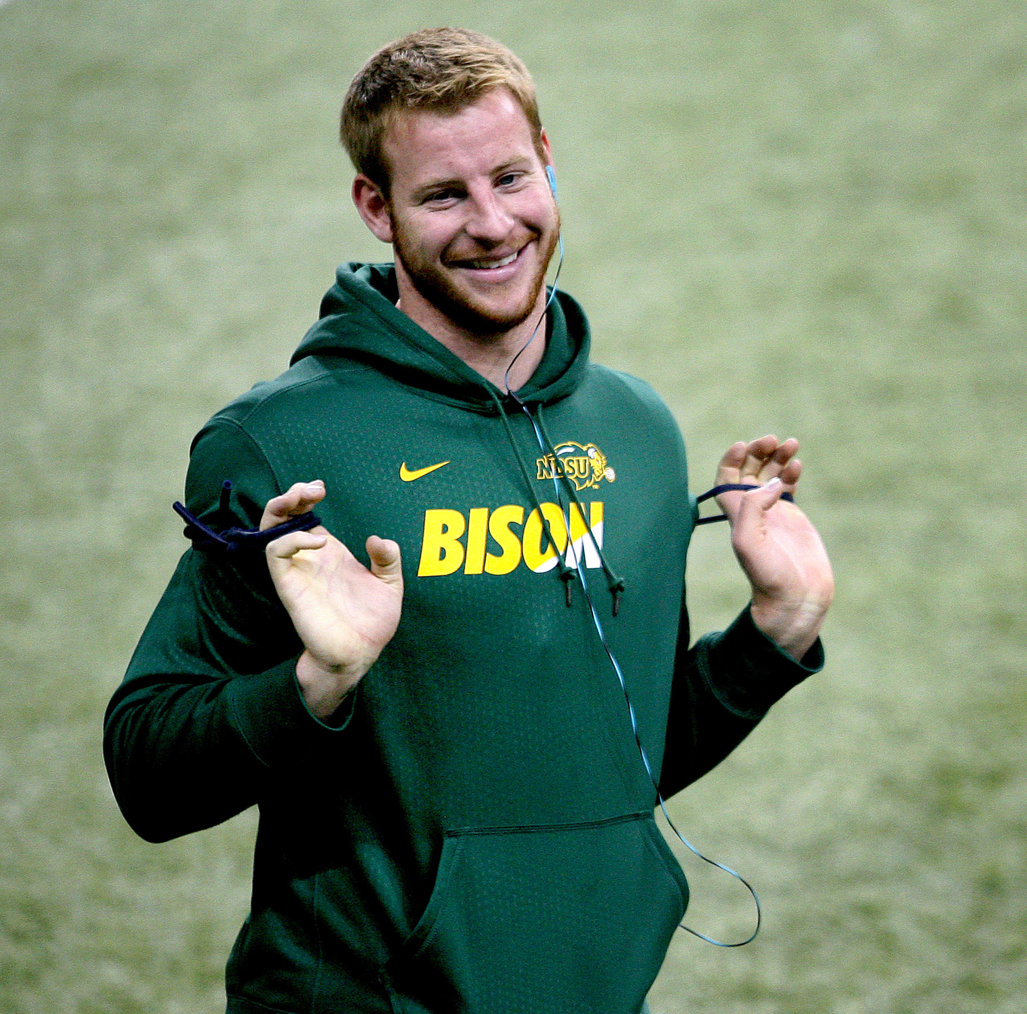Carson Wentz warms up as workouts begin during North Dakota State's NFL Pro Day, Thursday, March 24, 2016, in Fargo, N.D. (AP Photo/Bruce Crummy)