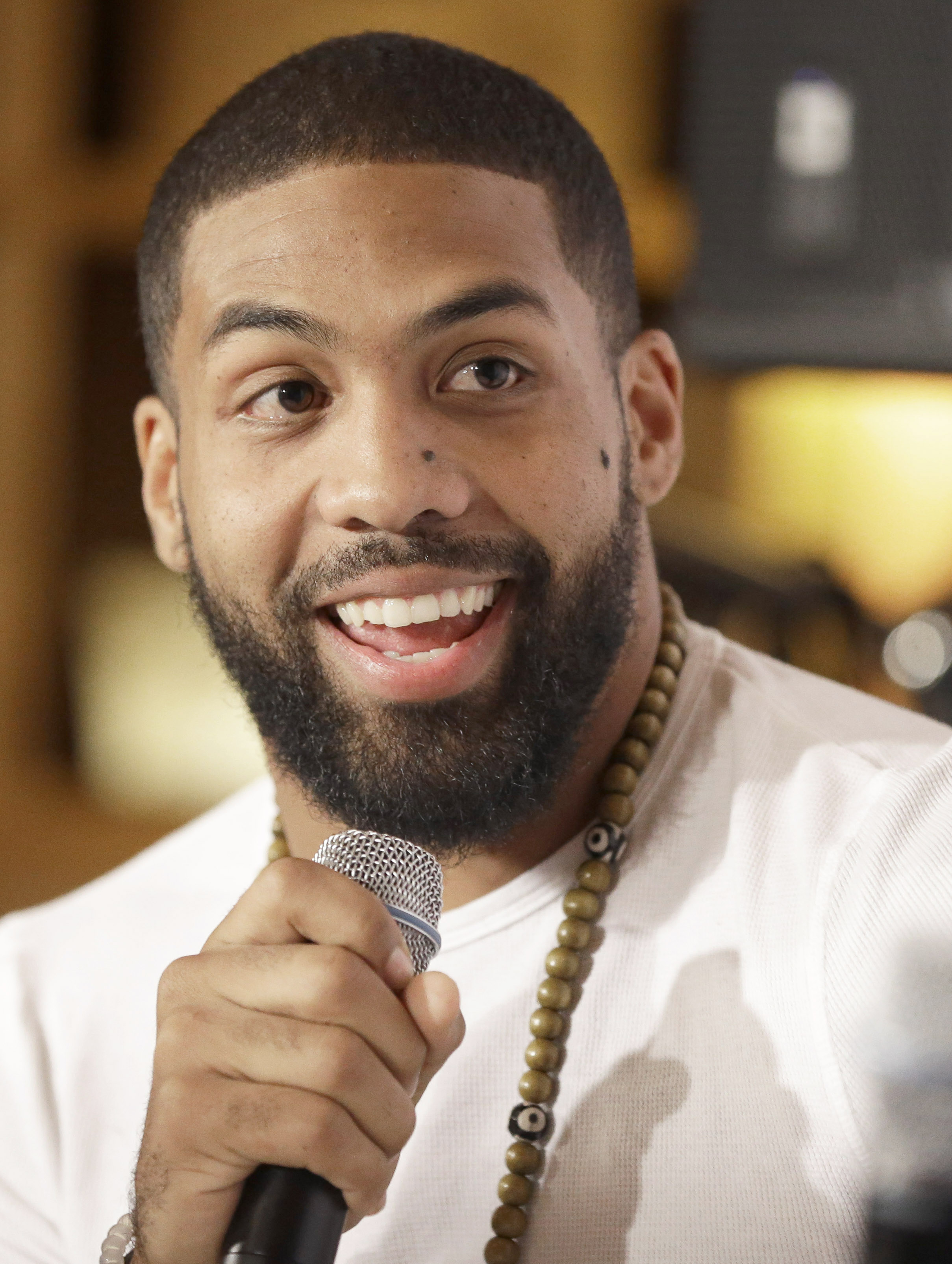Houston Texans running back Arian Foster laughs as he talks about mental health issues Saturday, Nov. 21, 2015, in Houston. Foster has joined New York Jets receiver Brandon Marshalls PROJECT 375, a nonprofit organization dedicated to eradicating the stigm