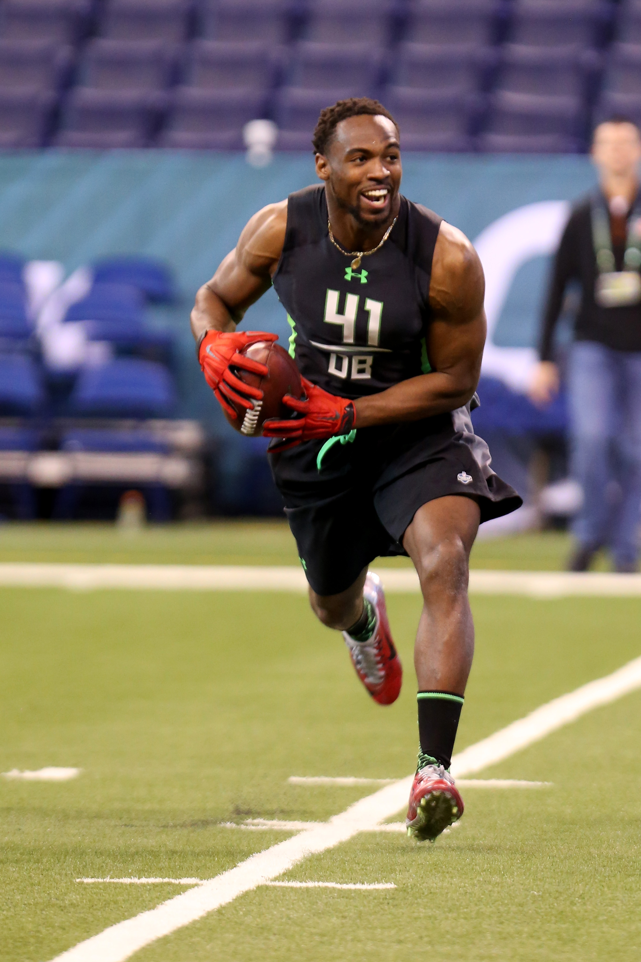 FILE - In this Feb. 29, 2016, file photo, Ohio State defensive back Tyvis Powell performs a drill at the NFL football scouting combine in Indianapolis. Powell often starts a conversation with a laugh. Every interaction is a chance to put a smile on someon