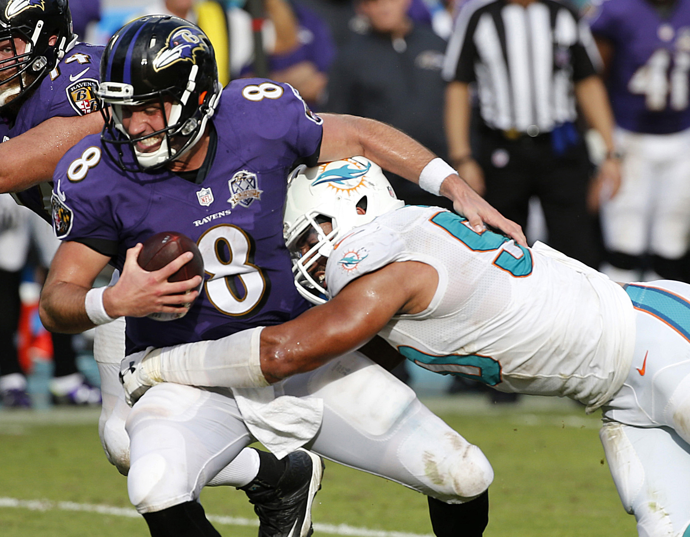 FILE - In this Dec. 6, 2015, file photo, Baltimore Ravens quarterback Matt Schaub (8) is sacked by Miami Dolphins defensive end Olivier Vernon (50), during the second half of an NFL football game, in Miami Gardens, Fla. New York Giants defensive coordinat