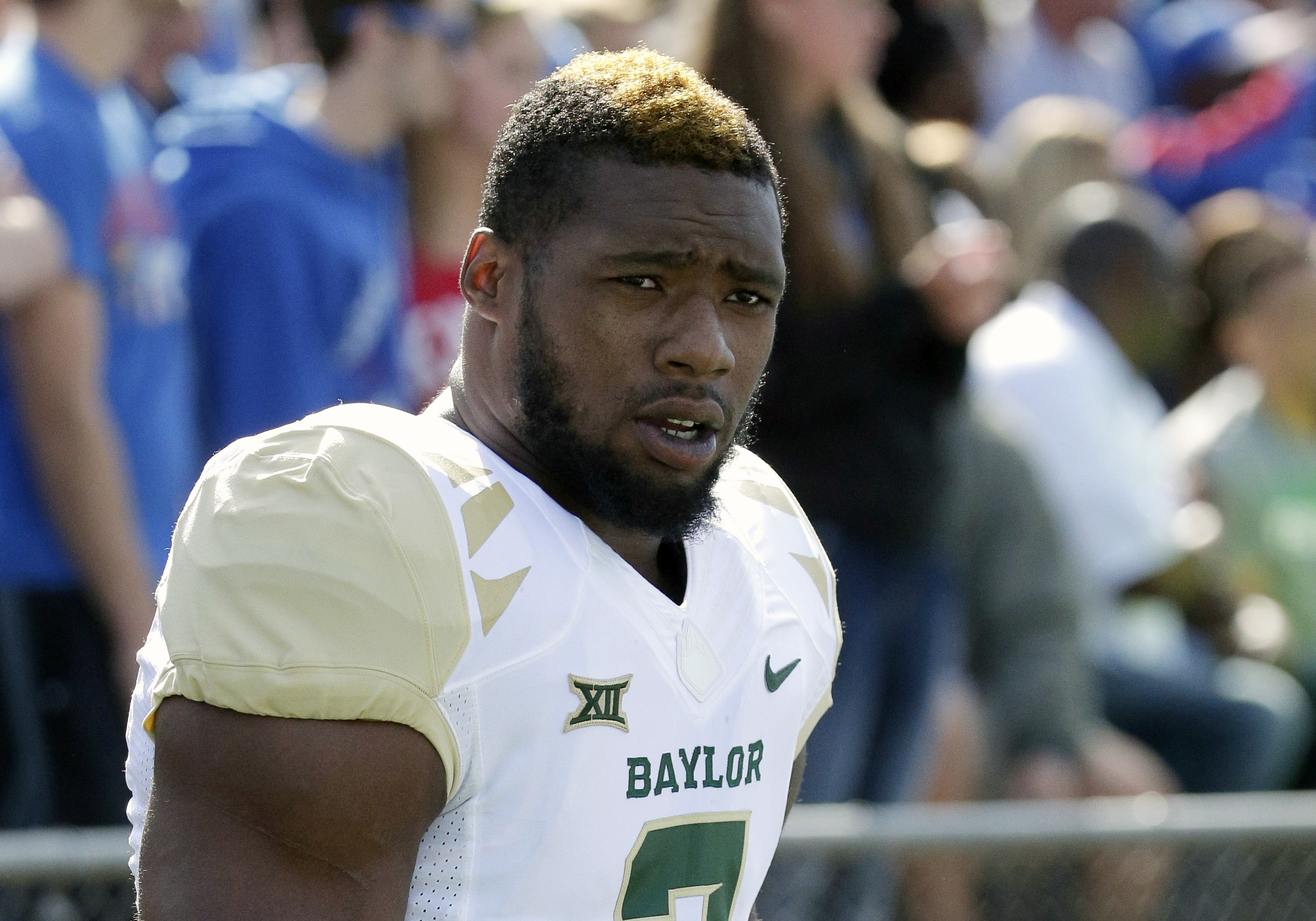 FILE - In this Oct. 10, 2015, file photo, then-Baylor defensive end Shawn Oakman warms up before an NCAA college football game against Kansas, in Lawrence, Kan. Texas authorities are investigating allegations by a woman who says she was sexually assaulted