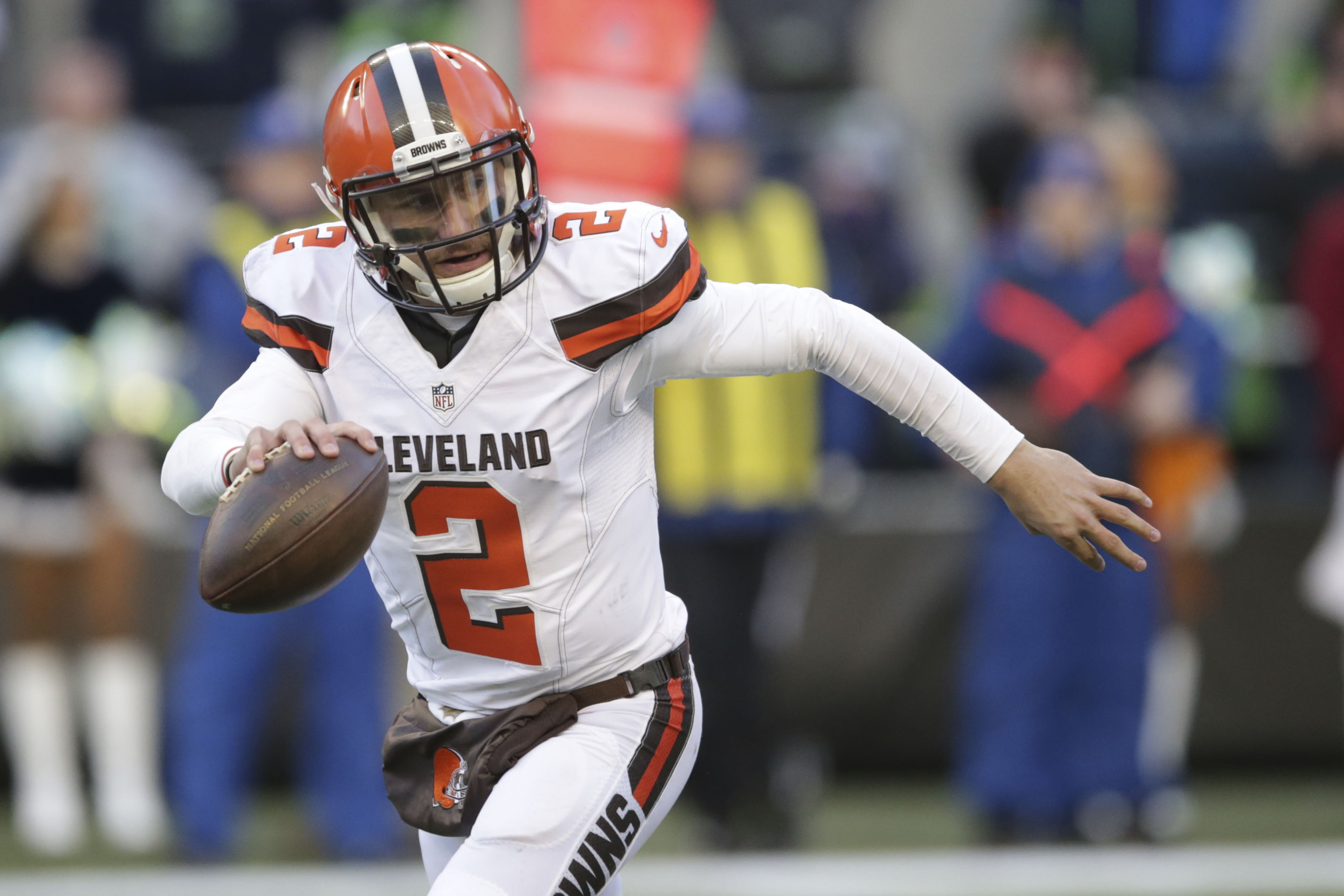 FILE - In this Sunday, Dec. 20, 2015 file photo, Cleveland Browns quarterback Johnny Manziel looks to pass against the Seattle Seahawks in the second half of an NFL football game in Seattle. Johnny Manziel's agent, Drew Rosenhaus, has told the troubled qu