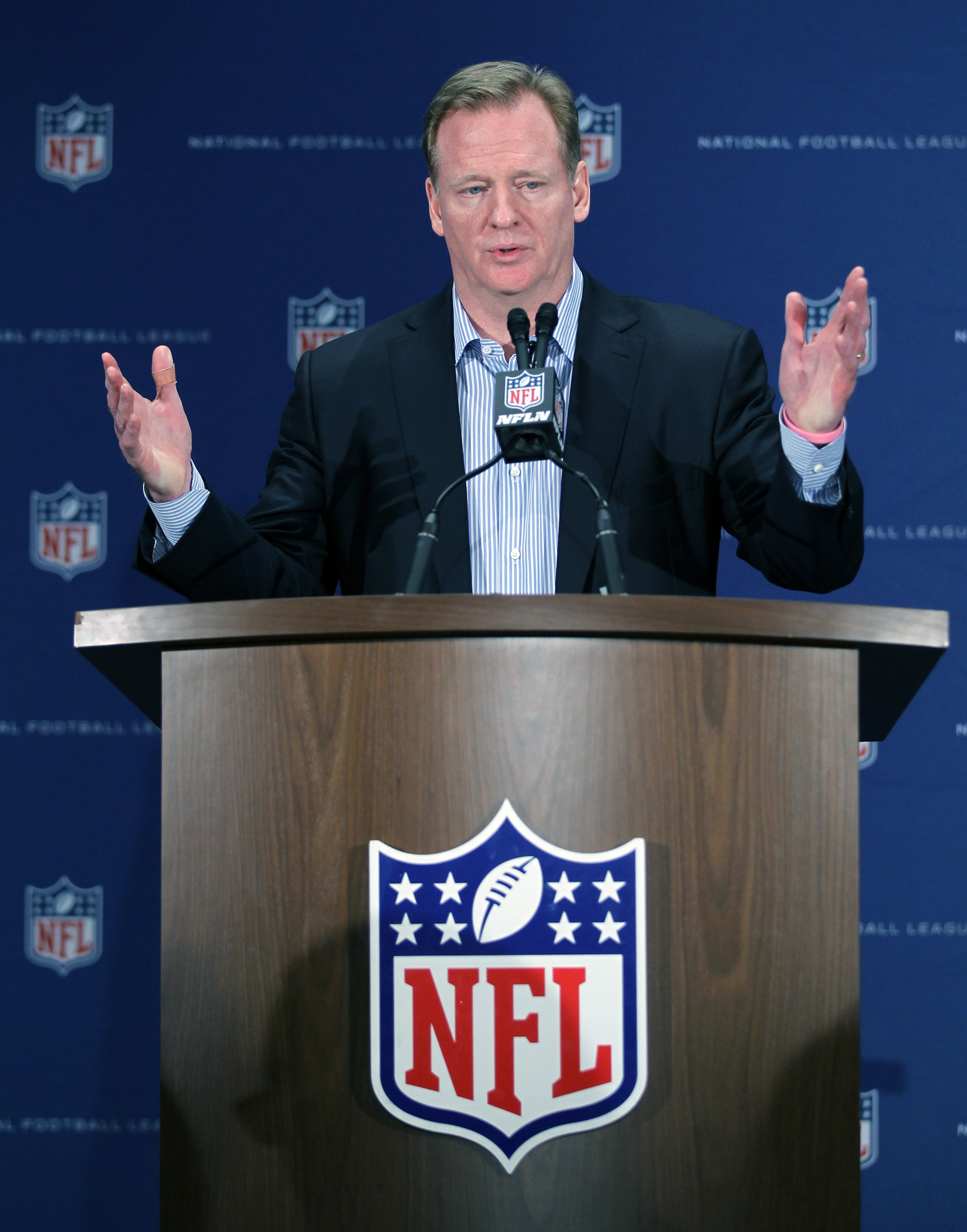 FILE - In this March 23, 2016, file photo, NFL Commissioner Roger Goodell gestures during a press conference at the NFL owners meeting in Boca Raton, Fla. The NFL has demanded The New York Times retract a story that called the league's concussion research