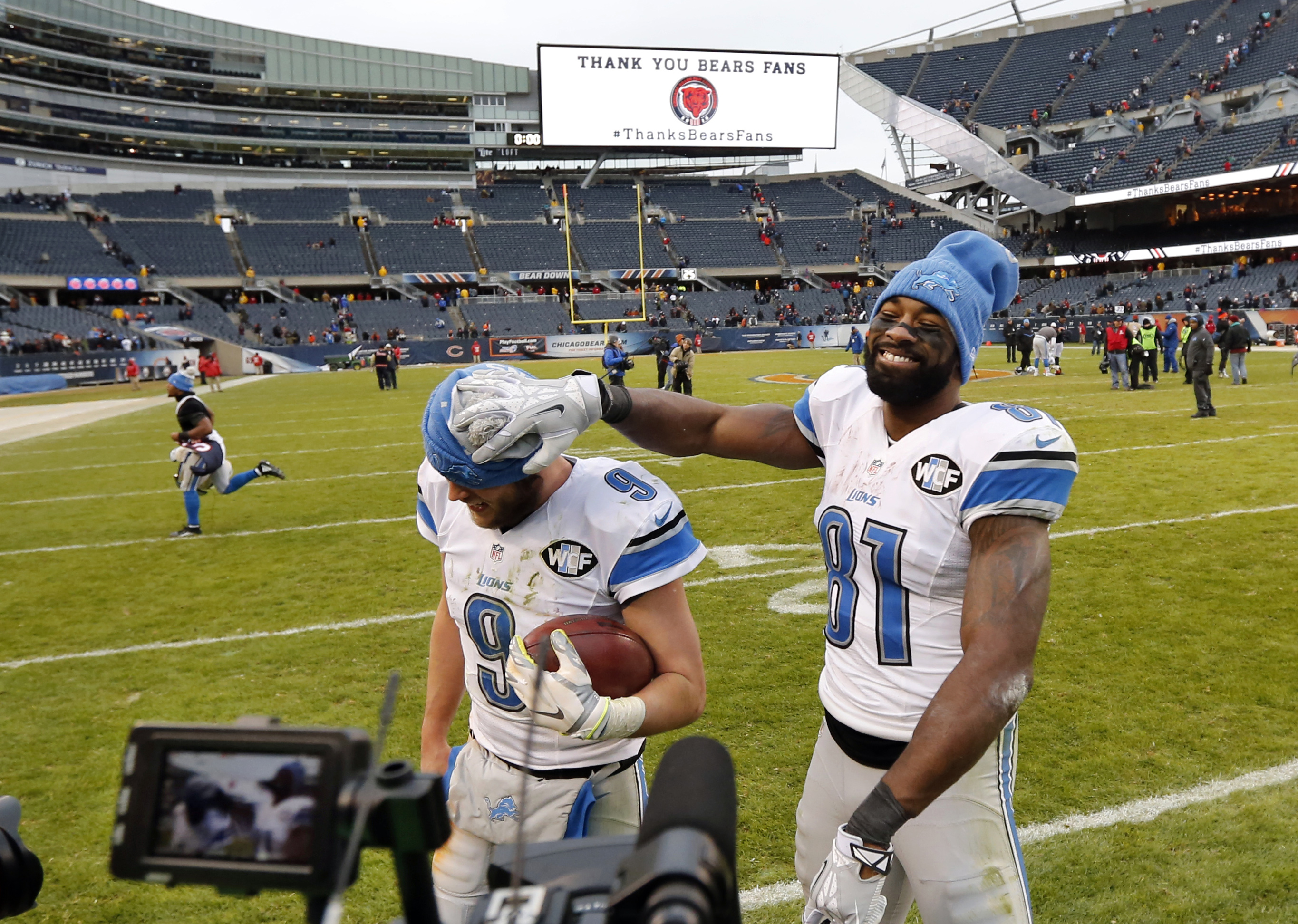 FILE - In this Jan. 3, 2016, file photo, Detroit Lions wide receiver Calvin Johnson (81) clowns around with quarterback Matthew Stafford (9) as they walk off the field after an NFL football game against the Chicago Bears in Chicago. The Lions have kicked