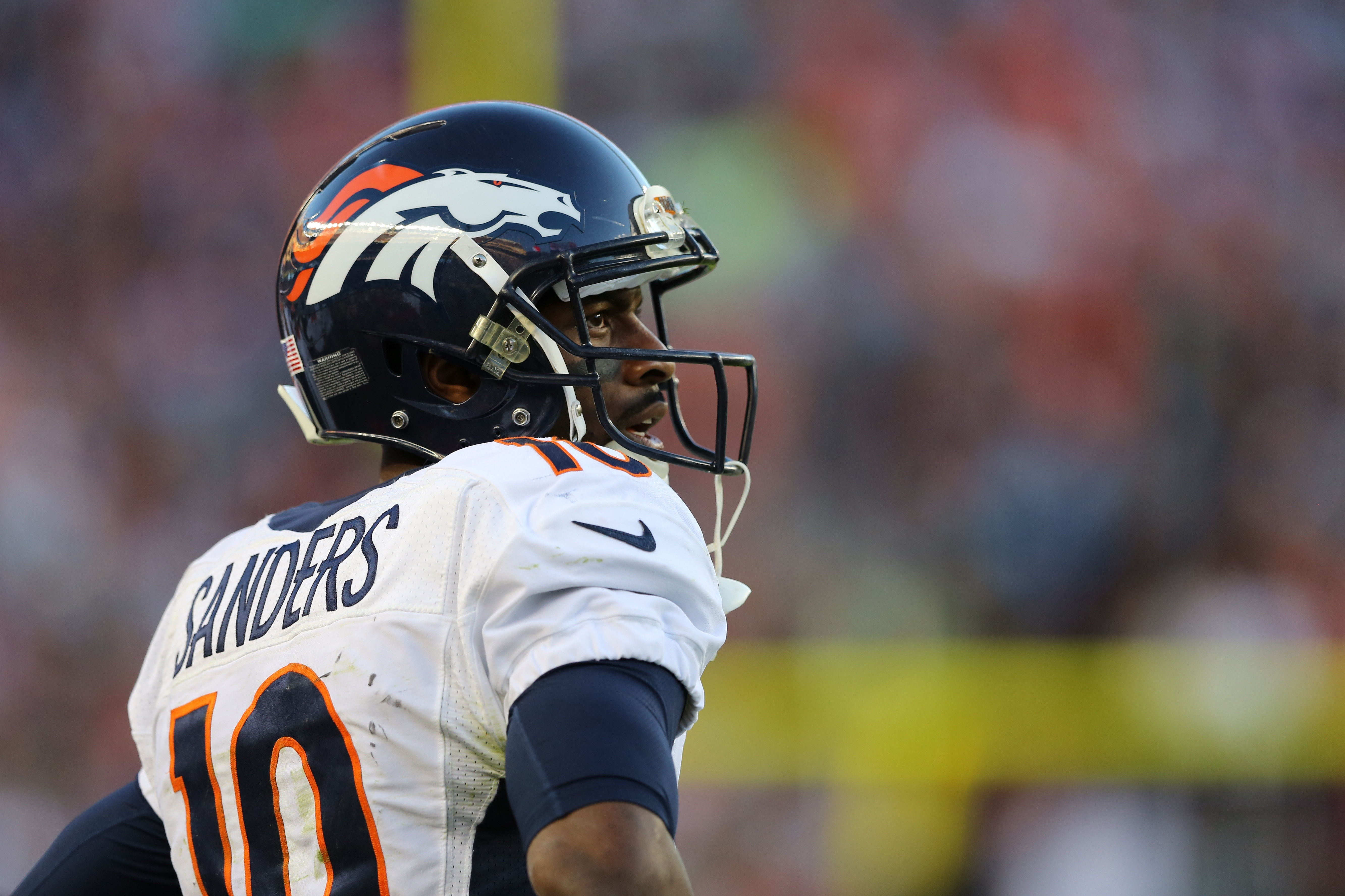 FILE - In this Feb. 7, 2016, file photo Denver Broncos Emmanuel Sanders watches from the sidelines against the  Carolina Panthers during the NFL football's Super Bowl 50 in Santa Clara, Calif. It's a new year, and while many of his teammates talk about pu