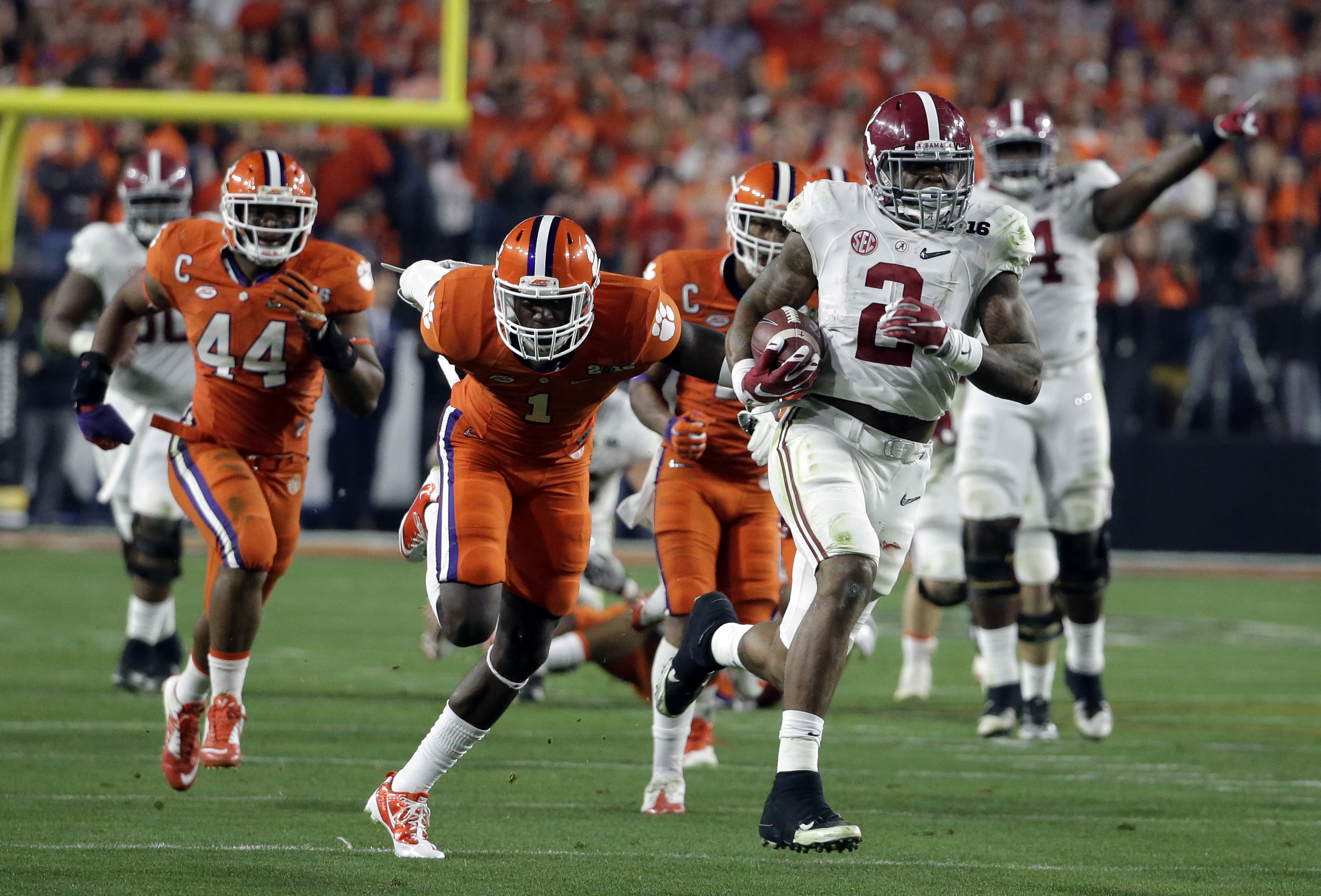 FILE - In this Jan. 11,2016, file photo, Alabama's Derrick Henry runs for a touchdown during the first half of the NCAA college football playoff championship game against Clemson in Glendale, Ariz. Henry figures to be either a late first-round or a second