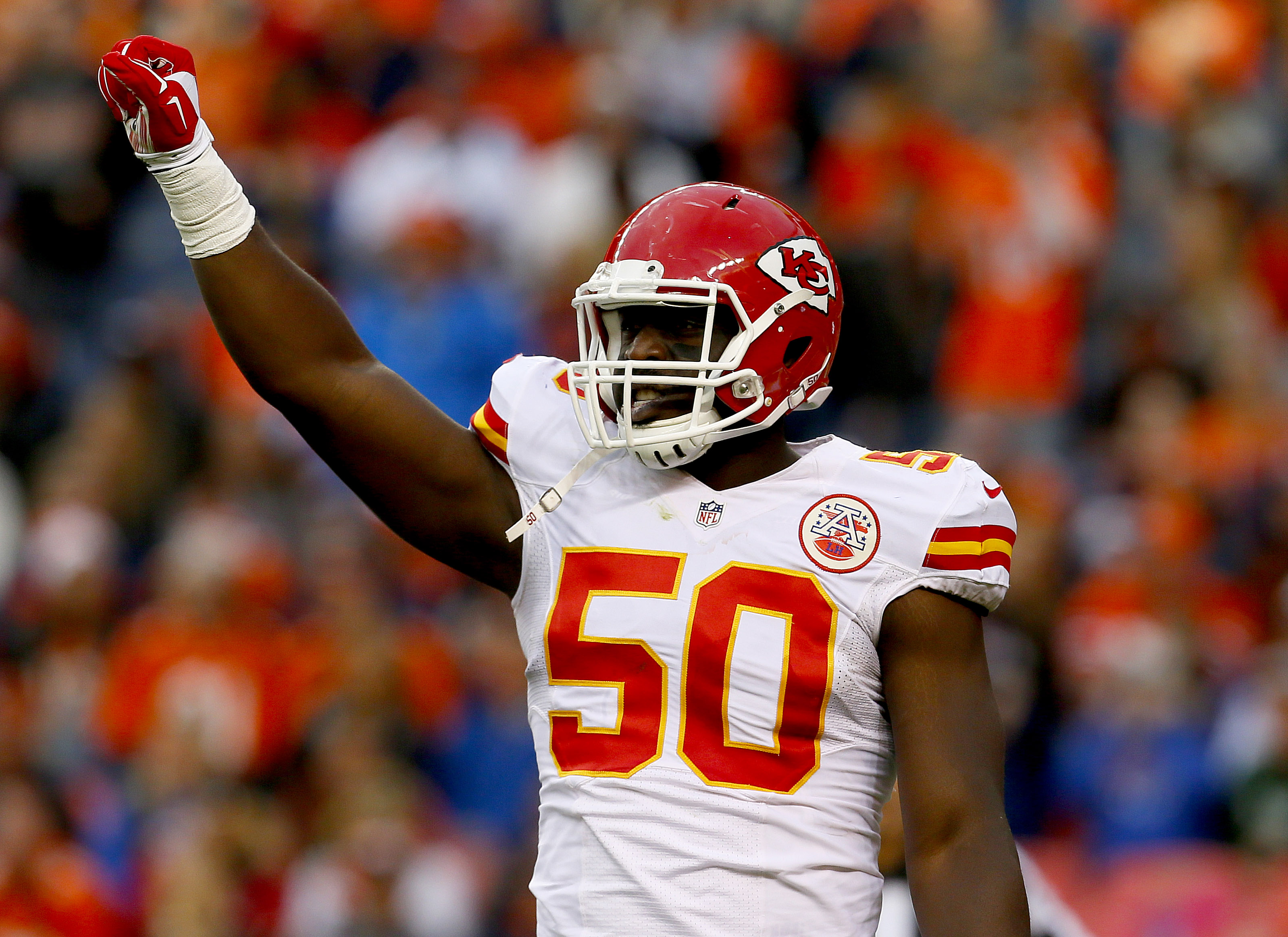Kansas City Chiefs outside linebacker Justin Houston (50) celebrates a stop during the second half of an NFL football game against the Denver Broncos, Sunday, Nov. 15, 2015, in Denver. (AP Photo/Joe Mahoney)