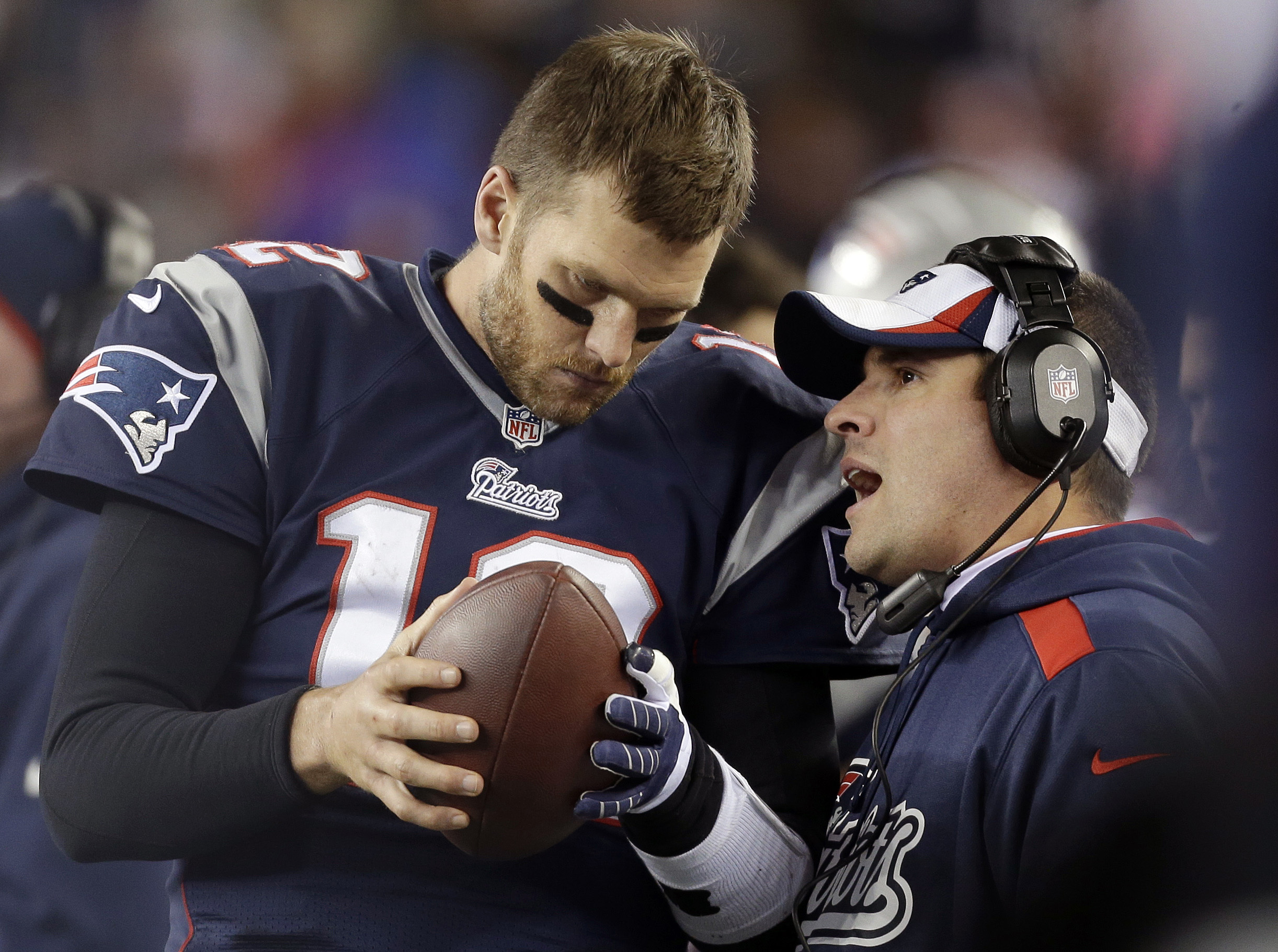 FILE - In this Nov. 3, 2013, file photo, New England Patriots offensive coordinator Josh McDaniels, right, talks to quarterback Tom Brady during the fourth quarter of an NFL football game against the Pittsburgh Steelers in Foxborough, Mass. A federal appe