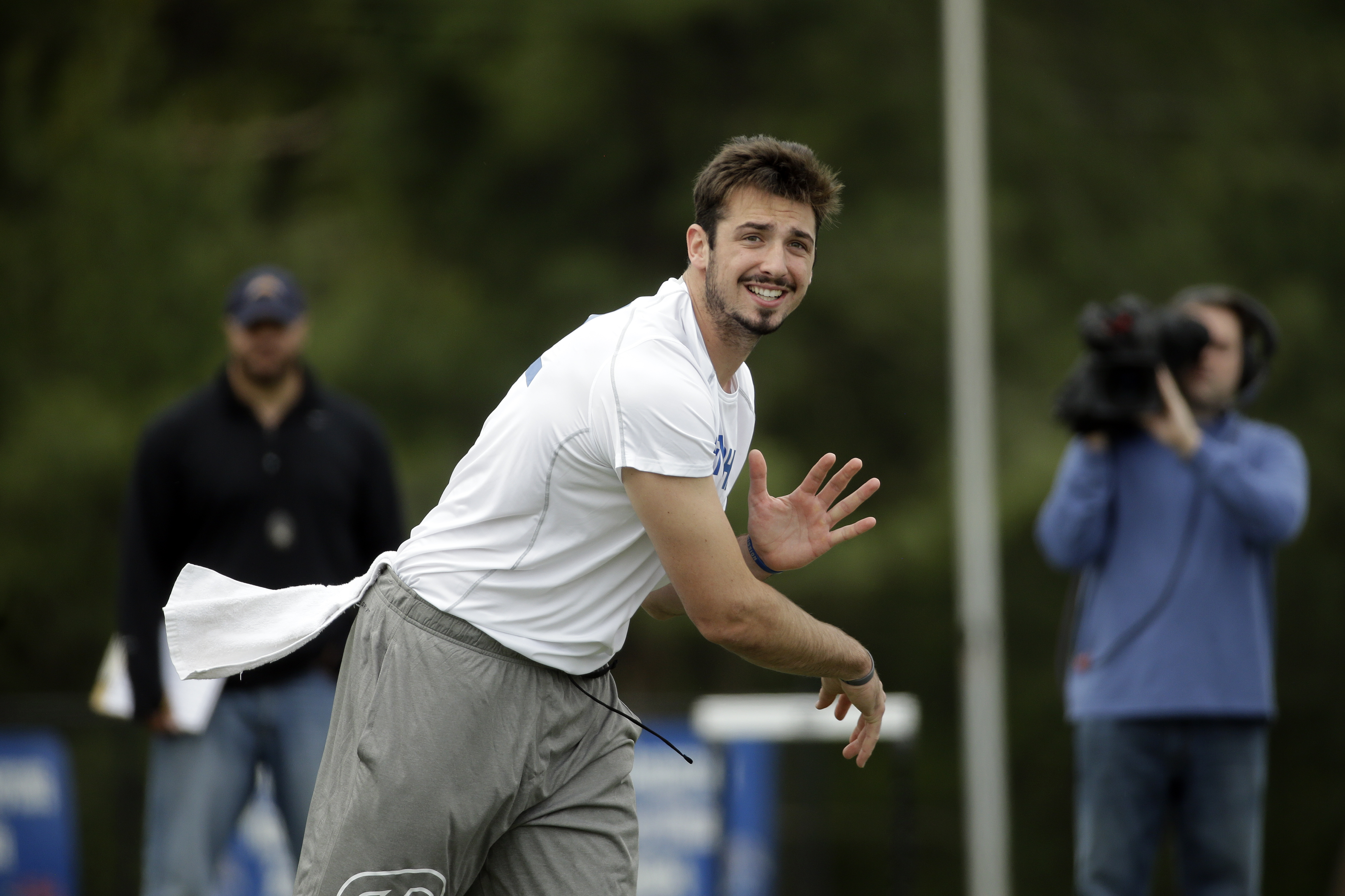 FILE - In this April 6, 2016 file photo, Memphis quarterback Paxton Lynch passes during the school's NFL football pro day, in Memphis, Tenn. A note from a Memphis administrator led Justin Fuente to a quarterback in Florida who taught himself how to throw