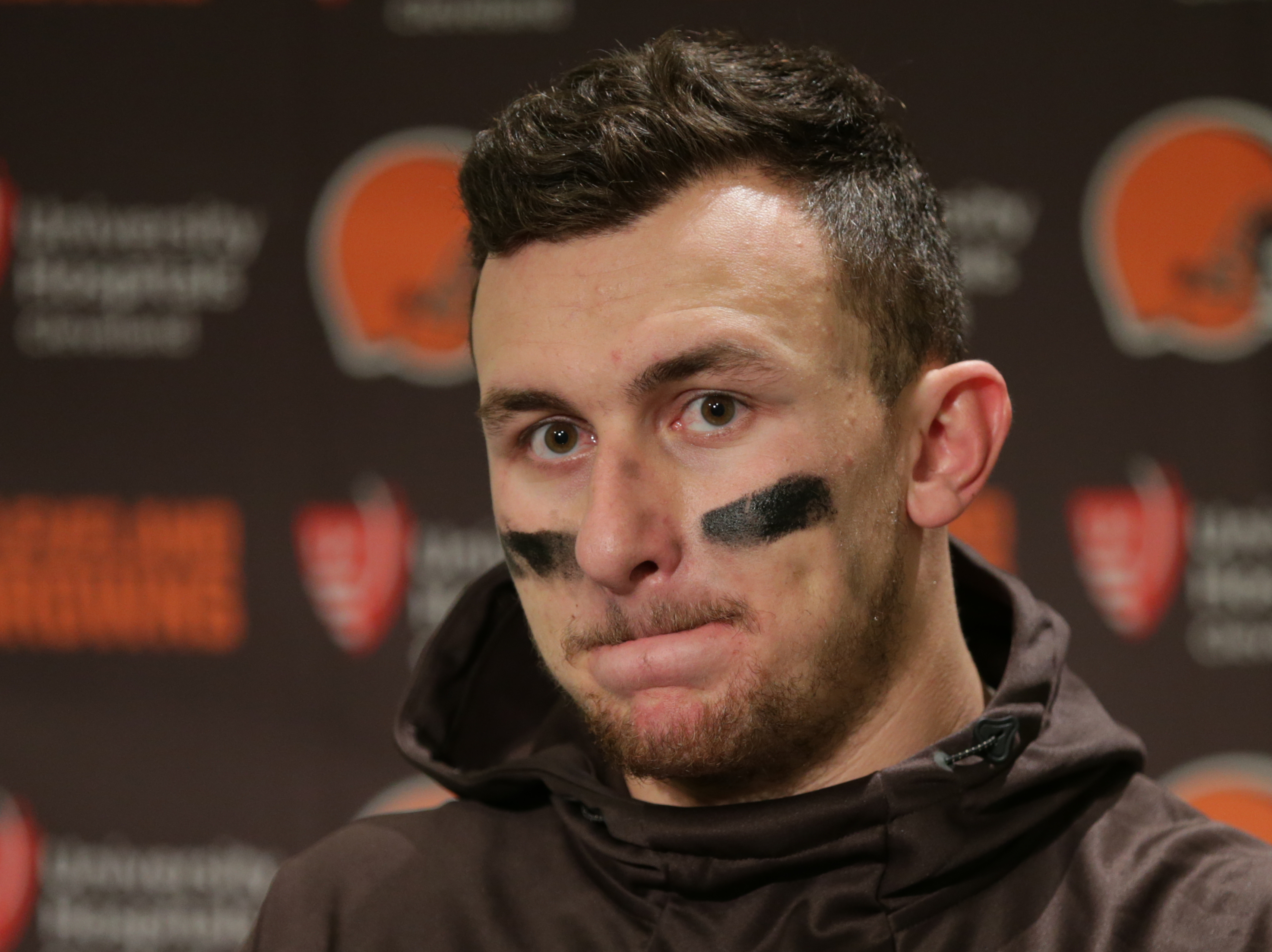 FILE - In this Dec. 20, 2015, file photo, Cleveland Browns quarterback Johnny Manziel speaks with media members following the team's 30-13 loss to the Seattle Seahawks in an NFL football game, in Seattle. A Dallas judge has set a $1,500 bond for former Cl
