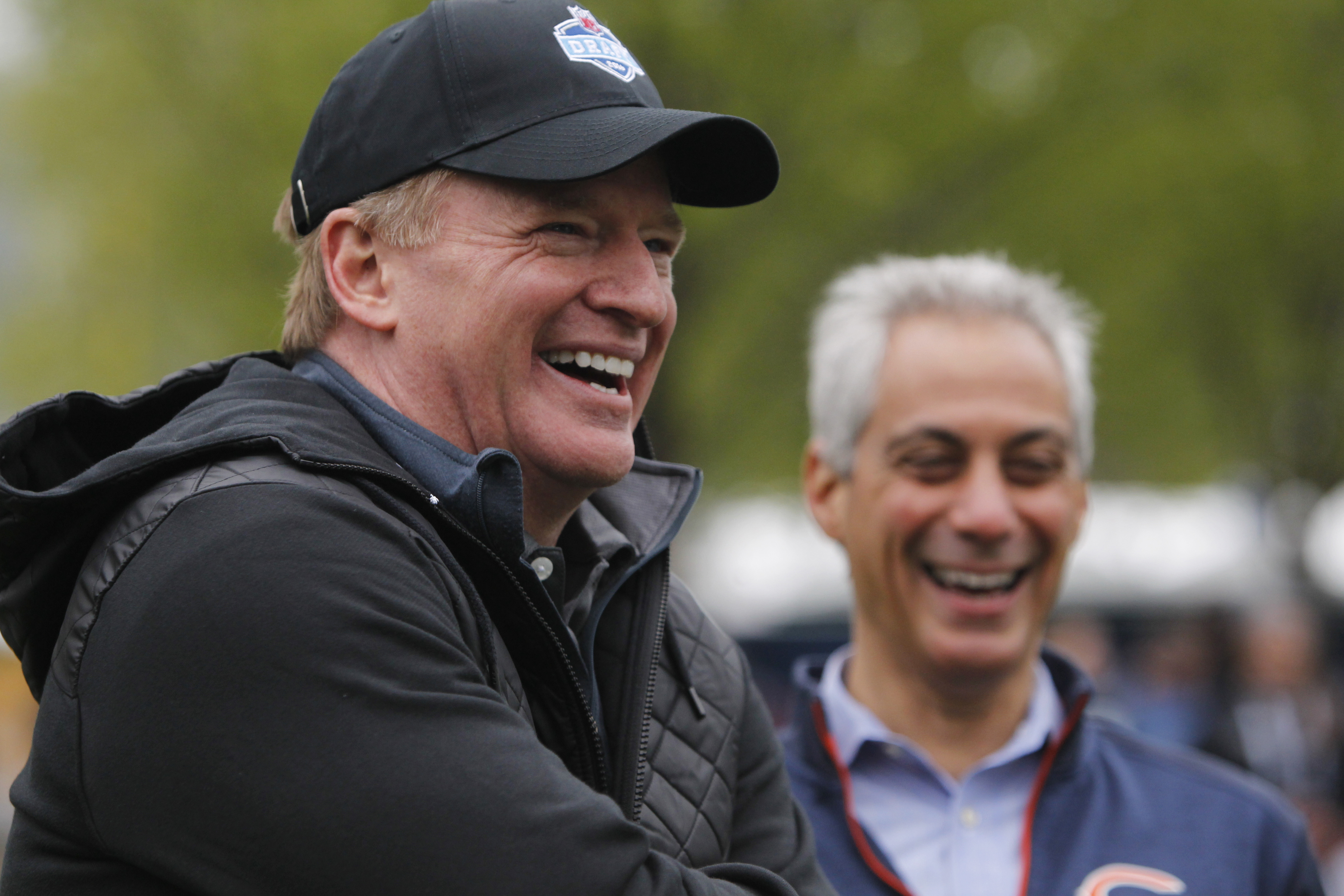 NFL Commissioner Roger Goodell, left,  laughs with Chicago Mayor Rahm Emanuel during an NFL Play 60 event at Grant Park, Wednesday, April 27, 2016, in Chicago before Thursday's first round of the NFL football draft. (AP Photo/Kiichiro Sato)
