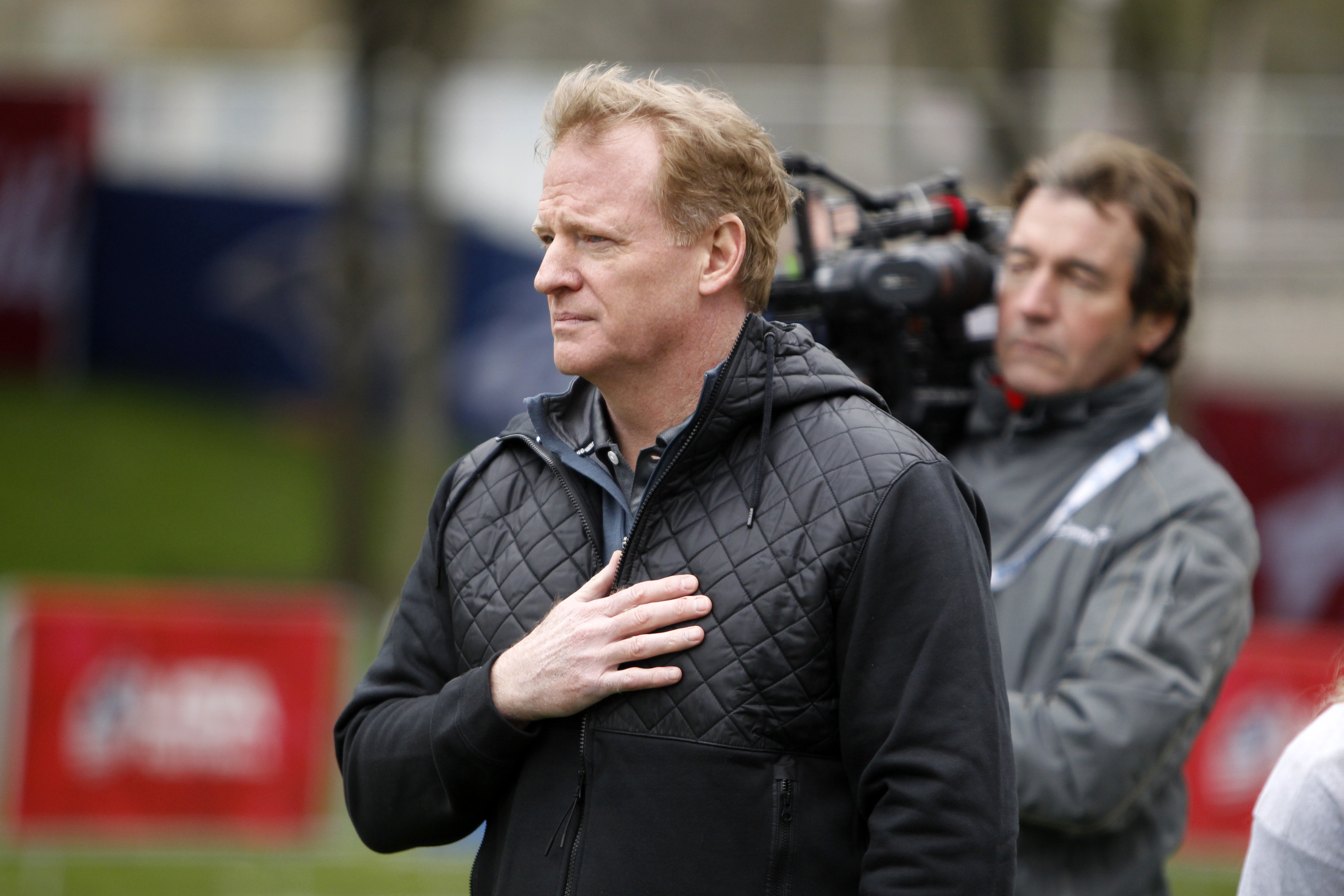 NFL Commissioner Roger Goodell pauses during the national anthem before an NFL Play 60 event at Grant Park, Wednesday, April 27, 2016, in Chicago before Thursday's first round of the NFL football draft. (AP Photo/Kiichiro Sato)