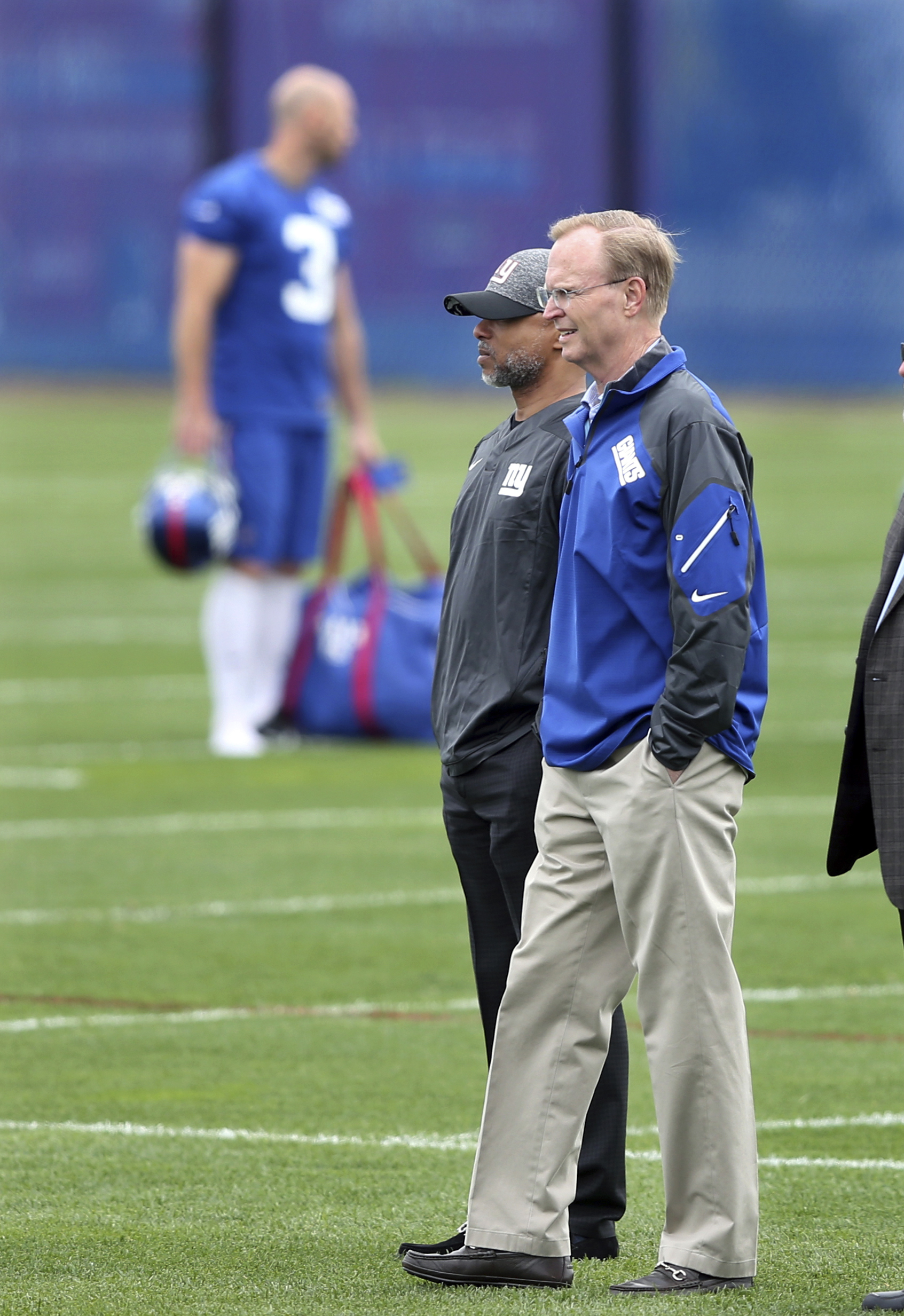 New York Giants co-owner John Mara, right, stands on the field with general manager Jerry Reese as they watch an NFL football minicamp Wednesday, April 27, 2016, in East Rutherford, N.J. (AP Photo/Mel Evans)