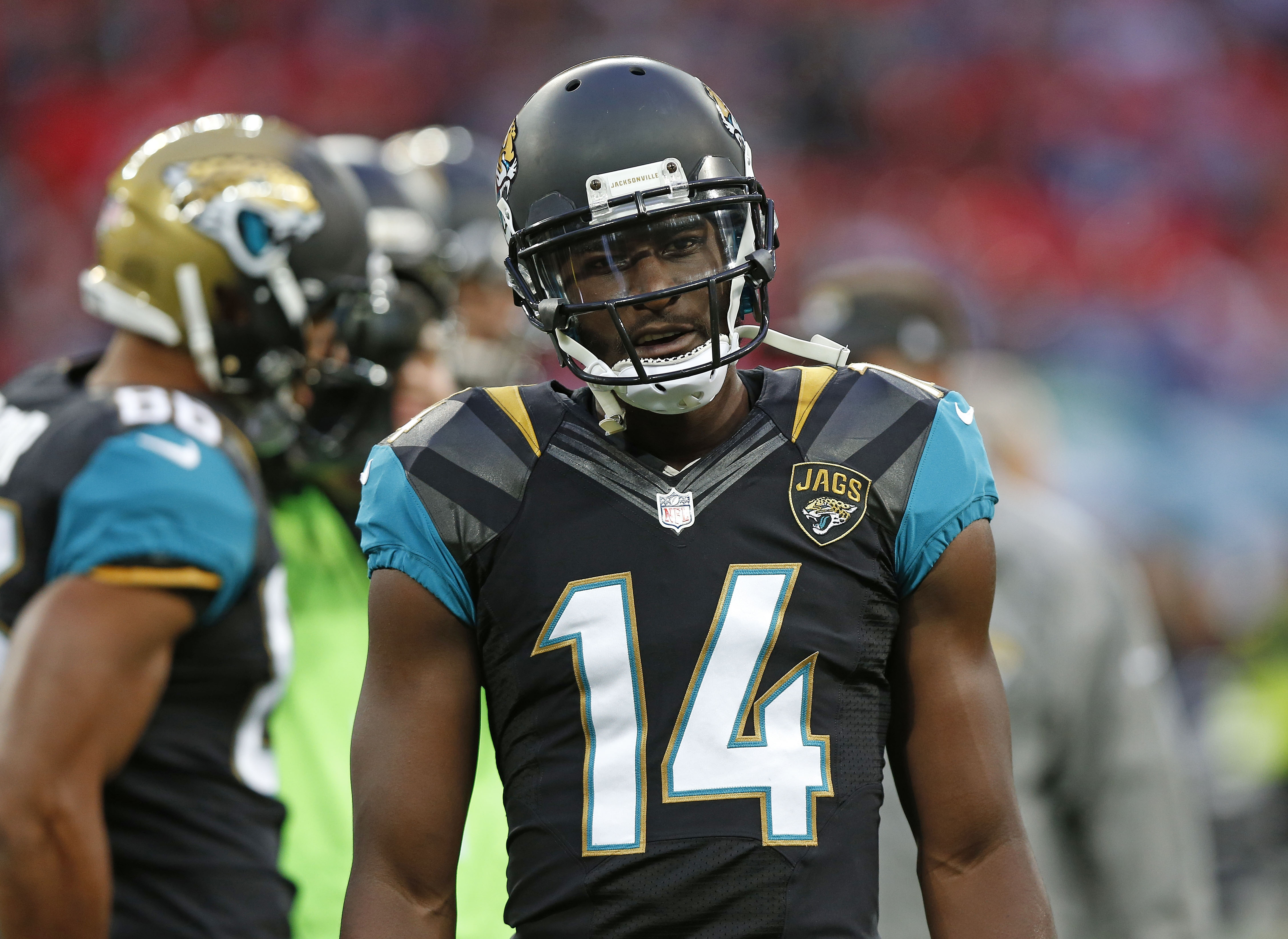 Jacksonville Jaguars wide receiver Justin Blackmon (14) walks onto the field for the warm-up at Wembley Stadium in London ahead of the NFL football game between San Francisco 49ers and Jacksonville Jaguars, Sunday, Oct. 27, 2013. (AP Photo/Sang Tan)