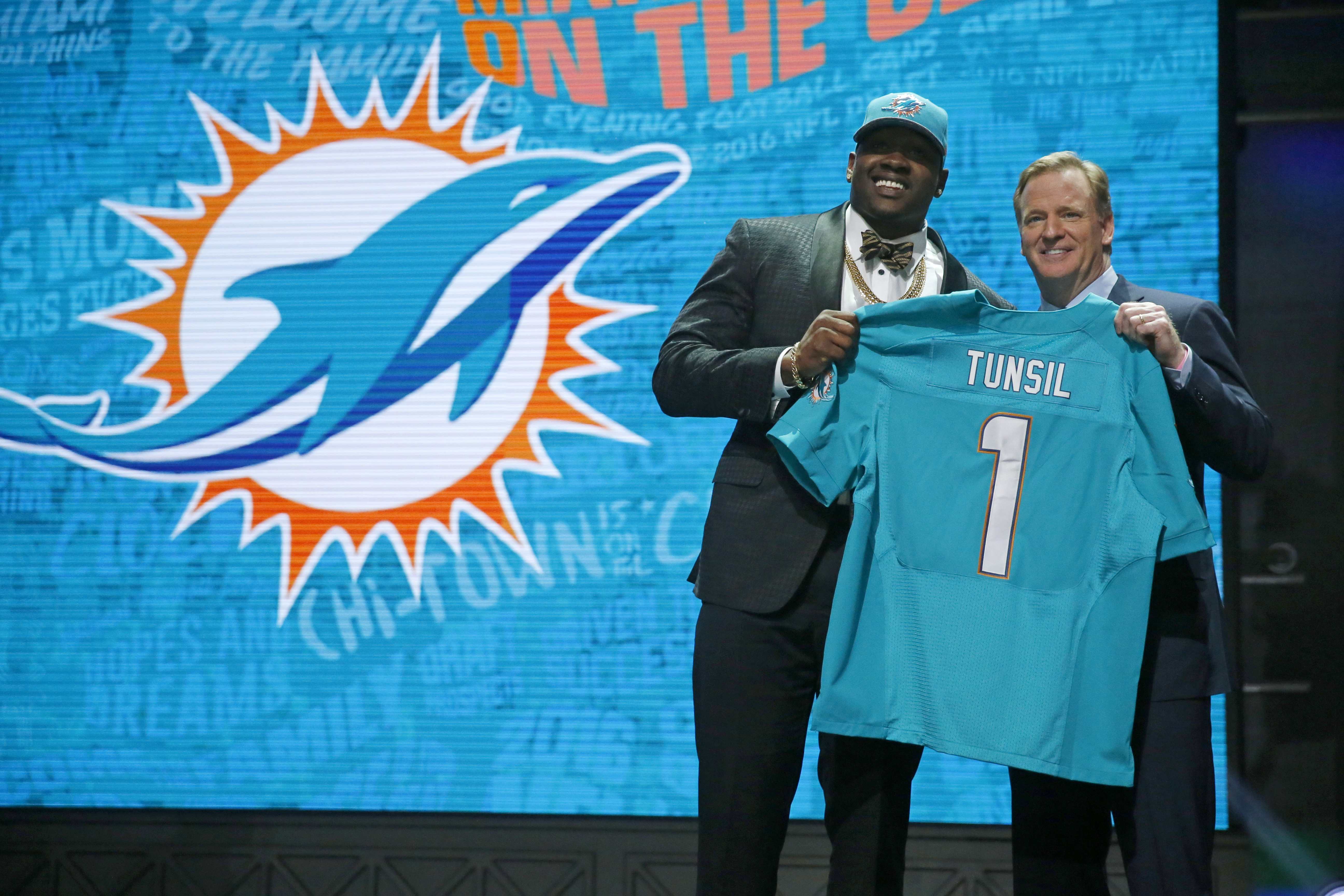 Mississippis Laremy Tunsil poses for photos with NFL commissioner Roger Goodell after being selected by the Miami Dolphins as the 13th pick in the first round of the 2016 NFL football draft, Thursday, April 28, 2016, in Chicago. (AP Photo/Charles Rex Arbo