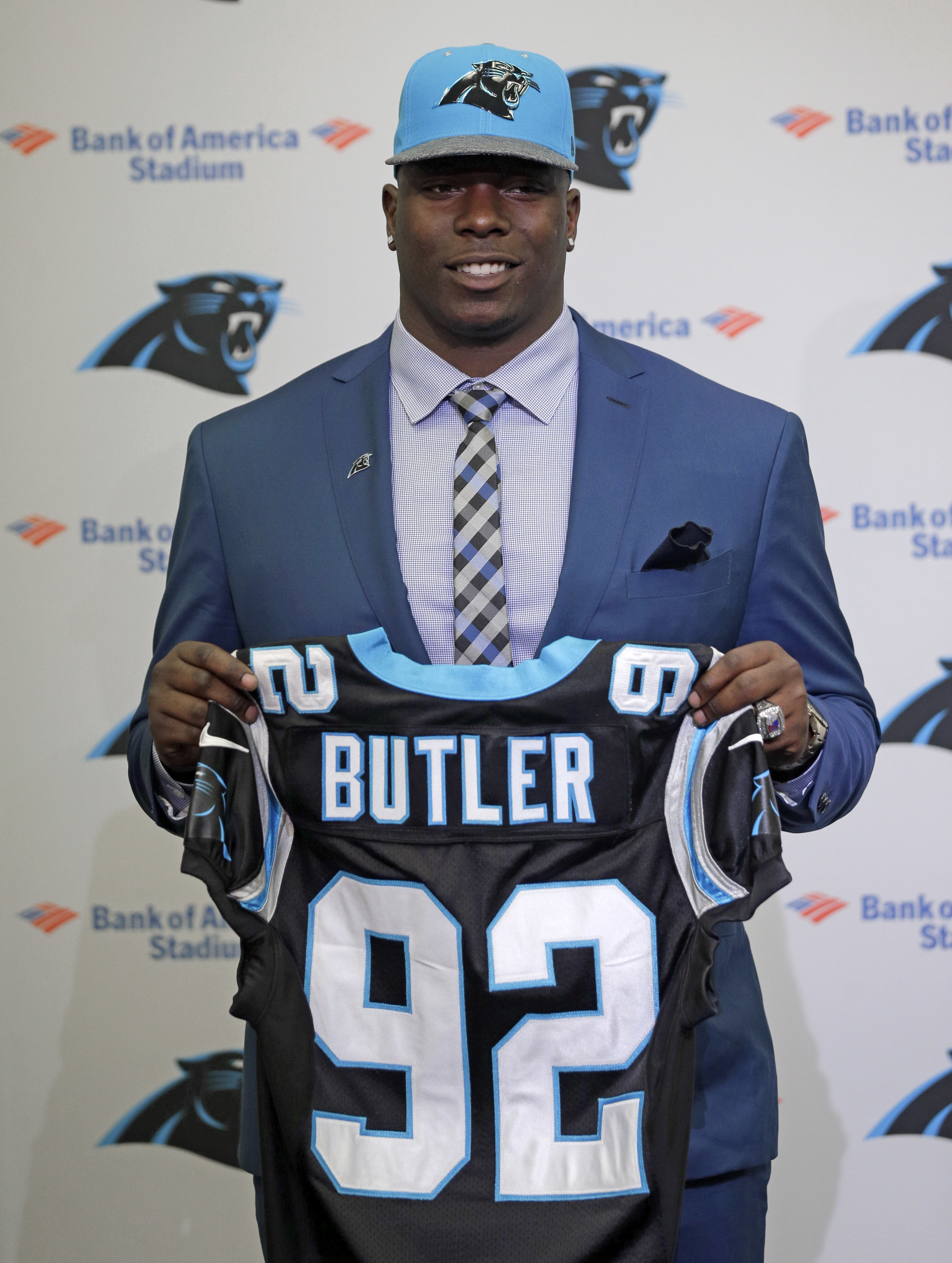 Carolina Panthers' Vernon Butler poses for a photo with a jersey during a news conference in Charlotte, N.C., Friday, April 29, 2016 after being chosen by the NFL football team with the 30th pick of the first round of the NFL Draft. (AP Photo/Chuck Burton