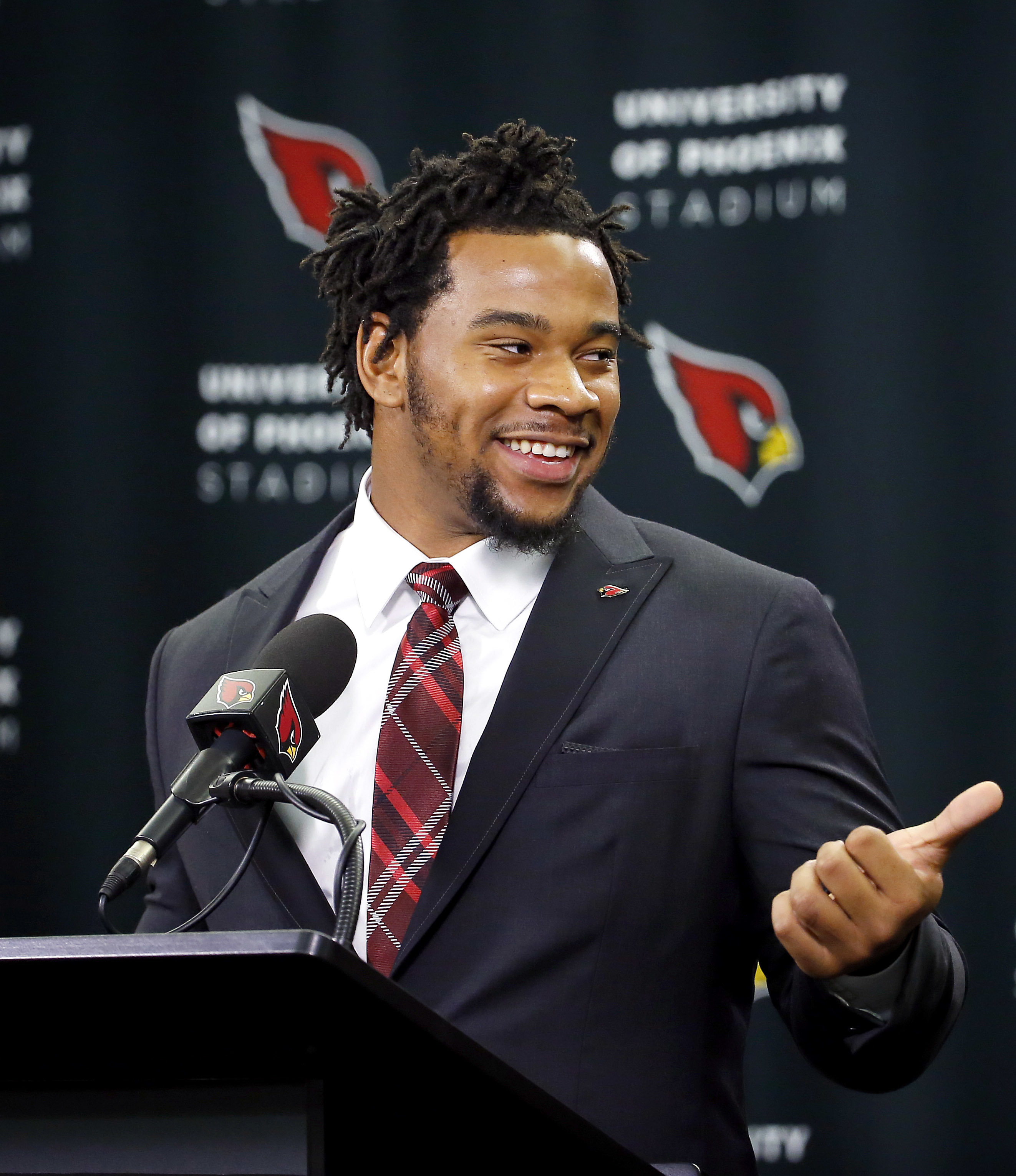 Arizona Cardinals' first-round draft pick Robert Nkemdiche points to head coach Bruce Arians after being introduced to the media, Friday, April 29, 2016, in Tempe, Ariz. Nkemdiche was the Cardinals' first round, 29th overall, pick in the NFL football draf