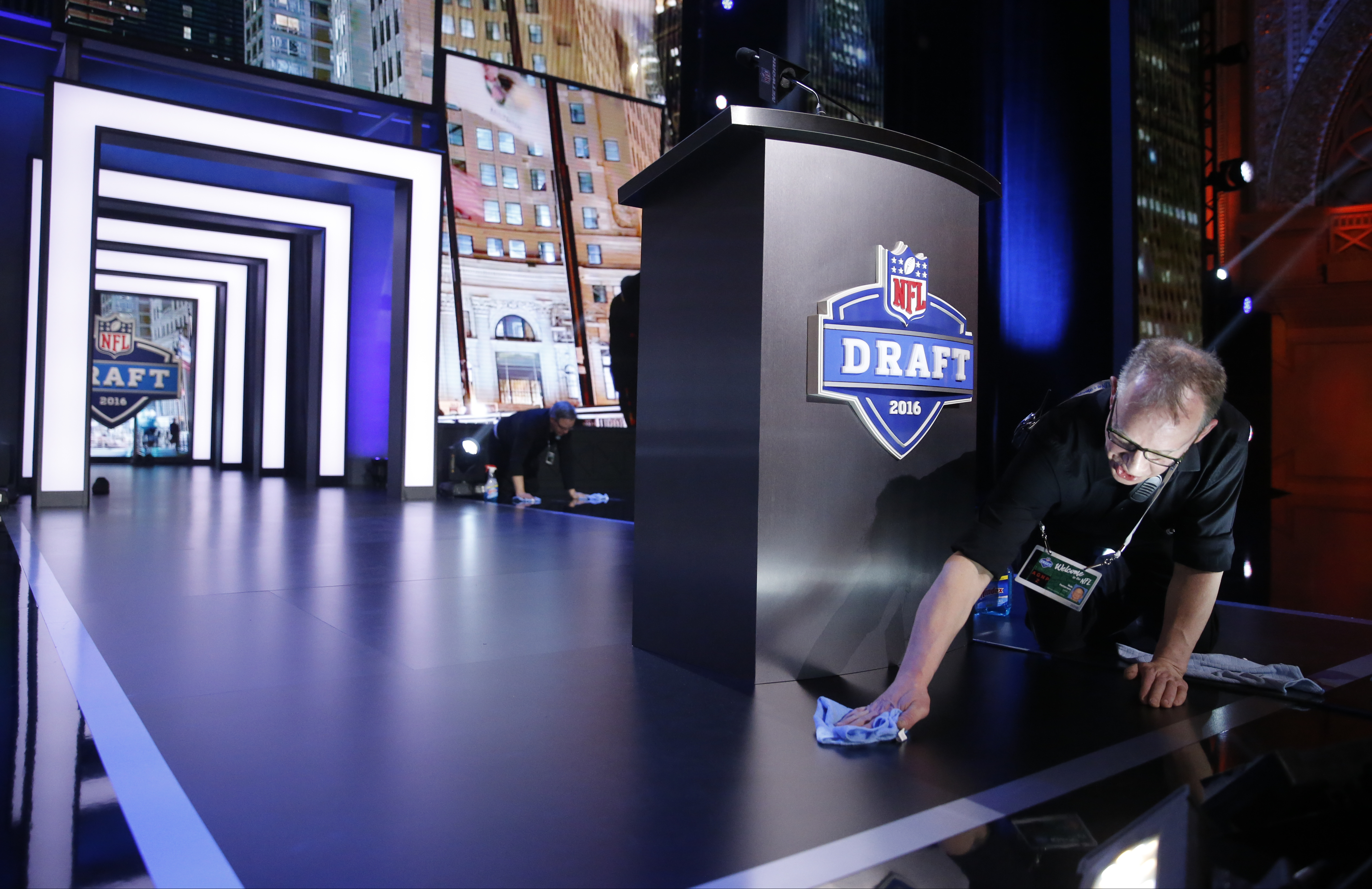 Robert Patterson prepare the stage at Auditorium Theater of Roosevelt University for the second and third rounds of the 2016 NFL football draft, Friday, April 29, 2016, in Chicago. (AP Photo/Charles Rex Arbogast)