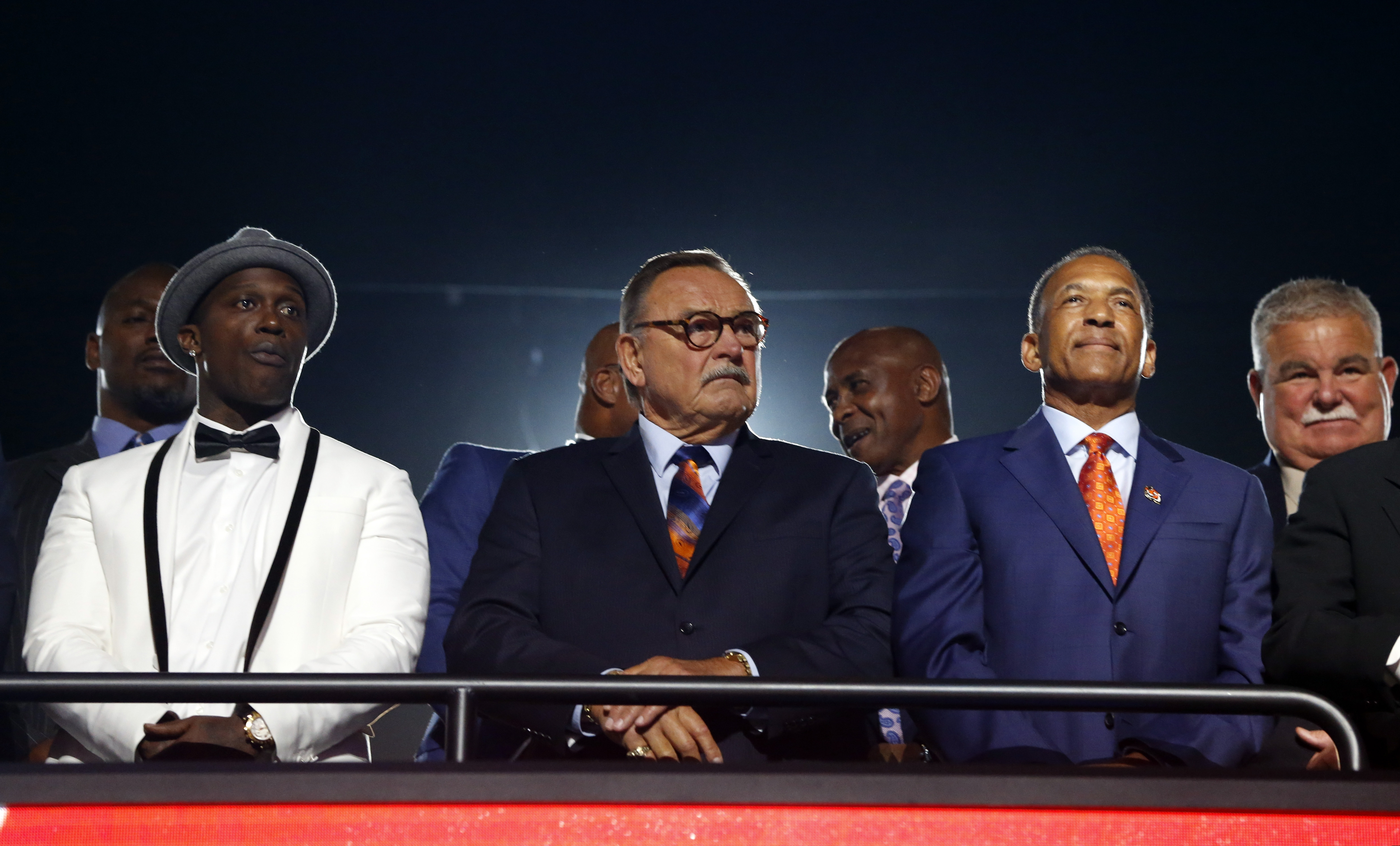 NFL Hall of Famer Dick Butkus, center, waits for the second round of the 2016 NFL football draft with former players, Friday, April 29, 2016, in Chicago. (AP Photo/Charles Rex Arbogast)