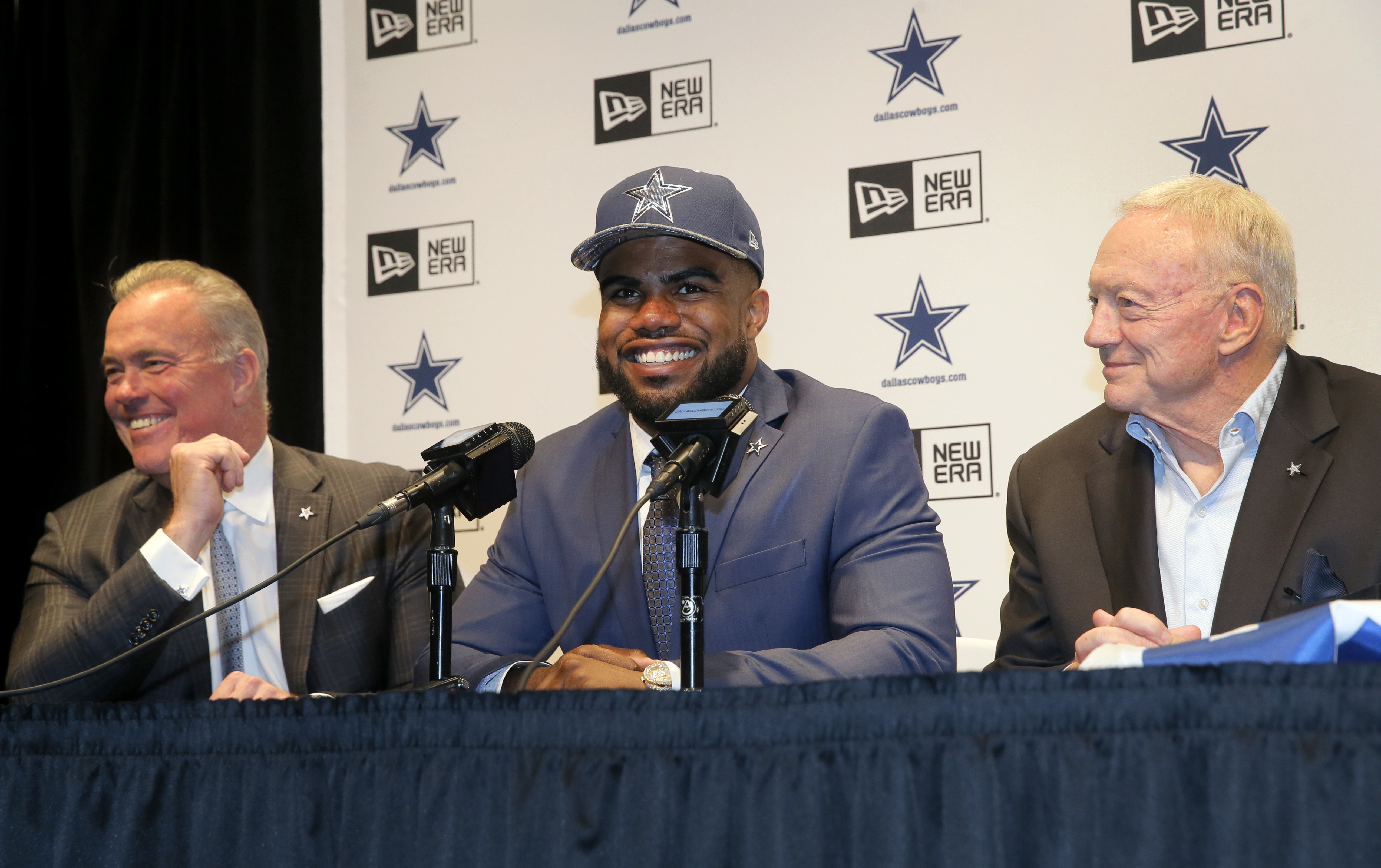 Dallas Cowboys Director of Player Personnel Stephen Jones, left, and team owner Jerry Jones, right, listen as first-round draft pick Ezekiel Elliott, center, answers questions at a news conference at the NFL football team's facility, Friday, April 29, 201
