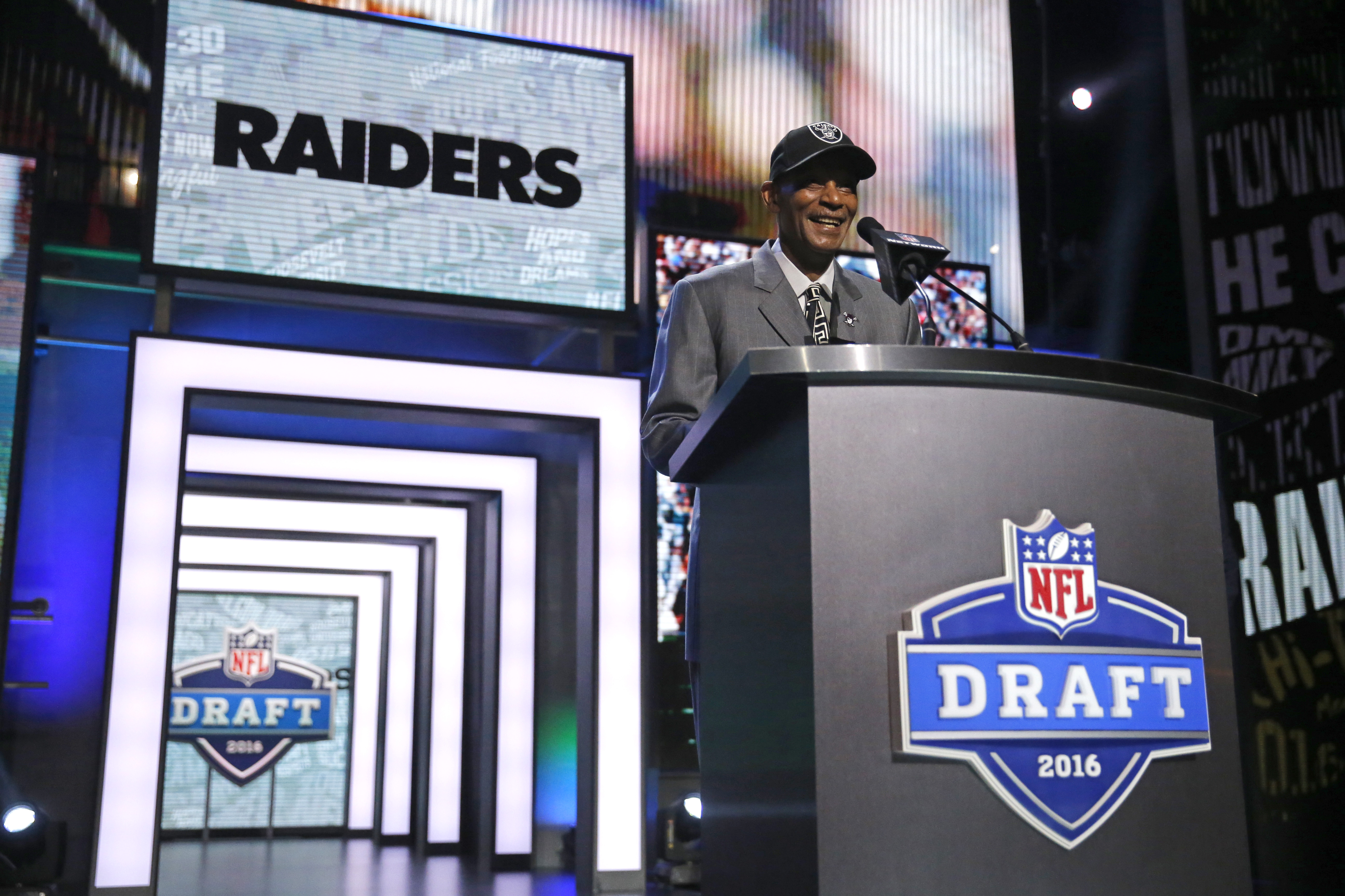 Former NFL player Willie Brown announces that the Oakland Raiders selects Illinois Jihad Ward as the 44th pick in the second round of the 2016 NFL football draft, Friday, April 29, 2016, in Chicago. (AP Photo/Charles Rex Arbogast)