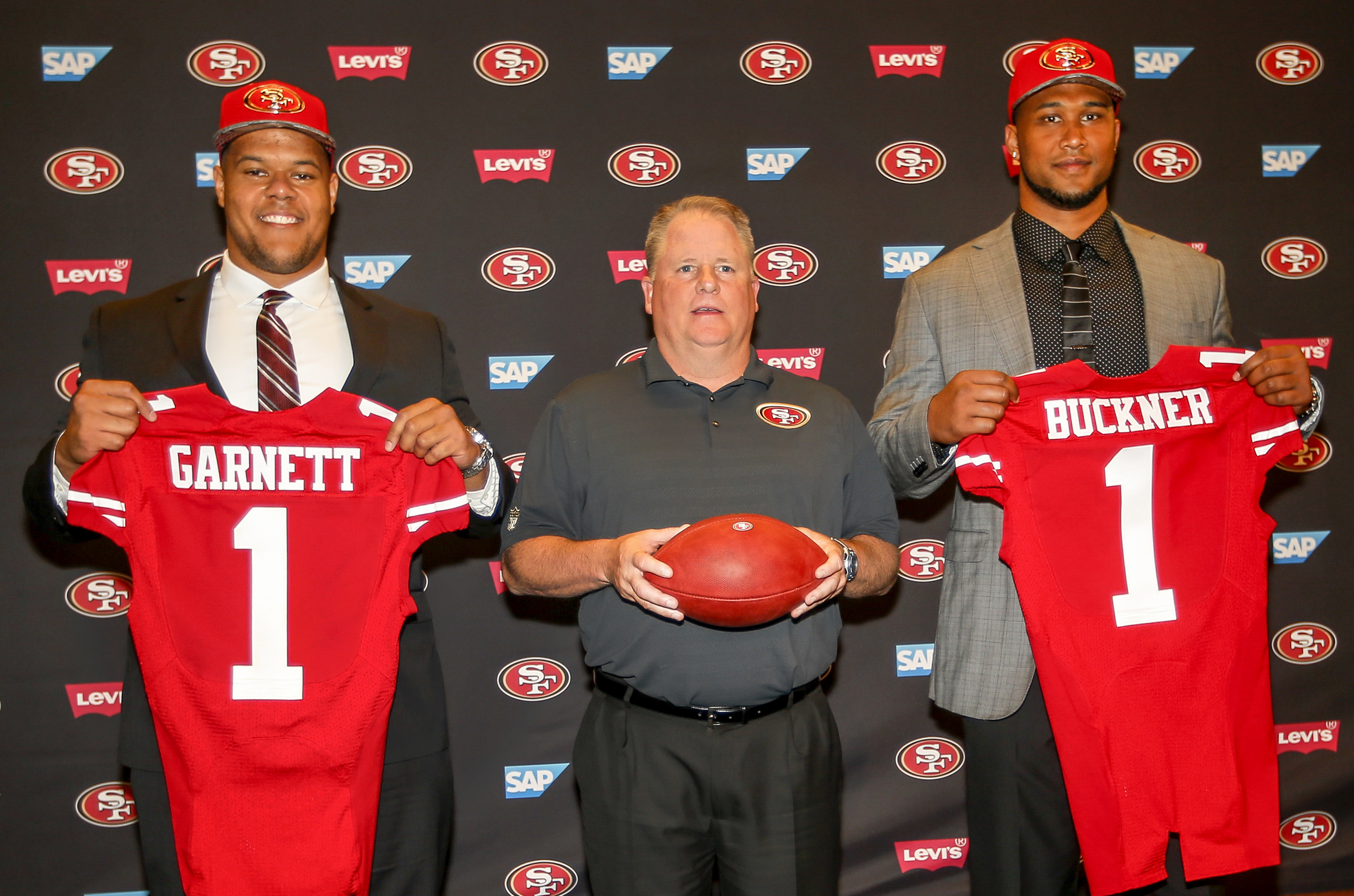 San Francisco 49ers first-round draft picks Joshua Garnett, left, from Stanford, and DeForest Buckner, right, from Oregon, pose with head coach Chip Kelly, center, during an NFL footnallnews conference in Santa Clara, Calif., Friday, April 29, 2016. (AP P