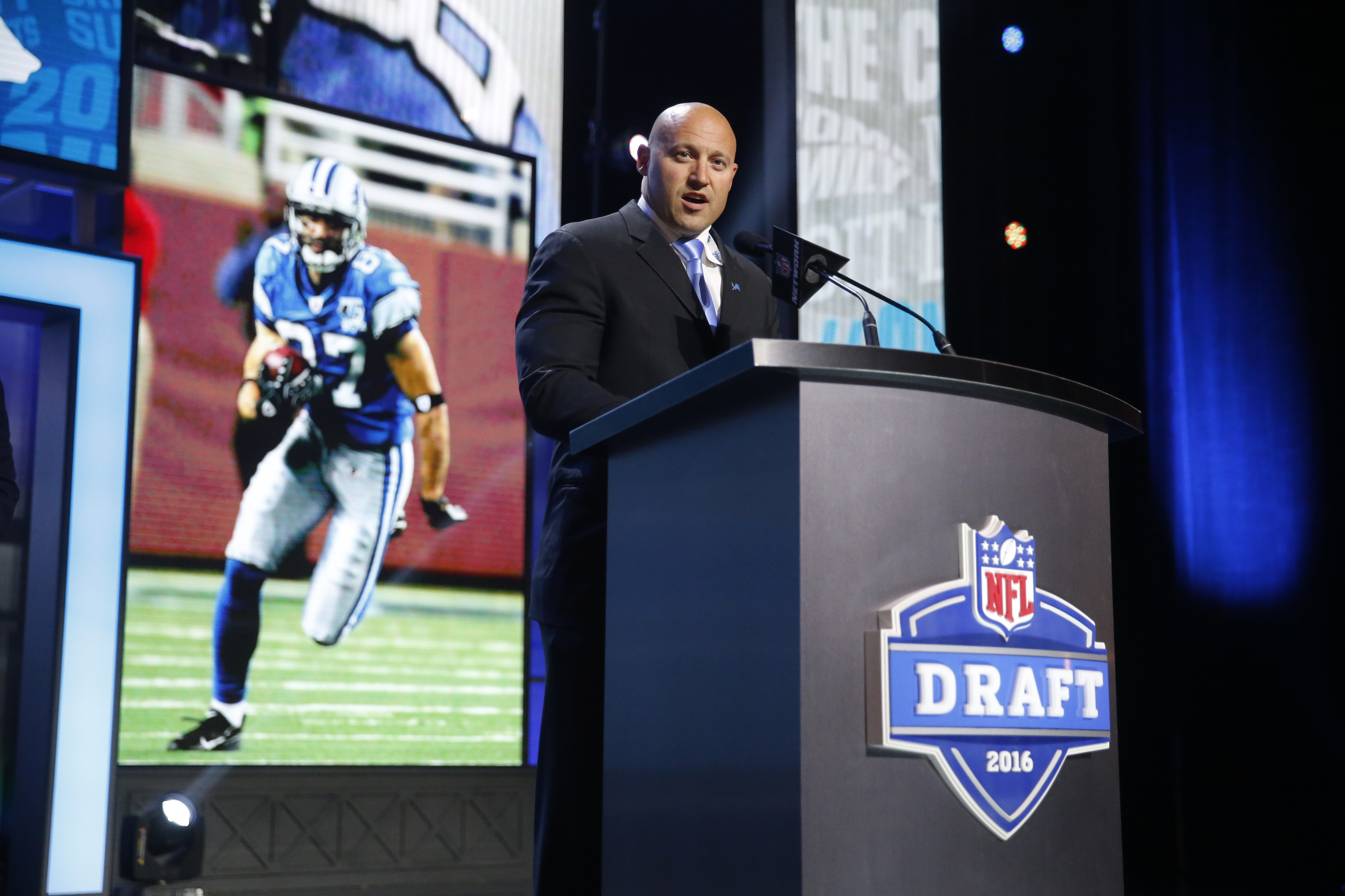 Former Walter Payton Men of the Year Mike Furrey announces that the Detroit Lions selects Michigans Graham Glasgow as the 95th pick in the third round of the 2016 NFL football draft, Friday, April 29, 2016, in Chicago. (AP Photo/Charles Rex Arbogast)