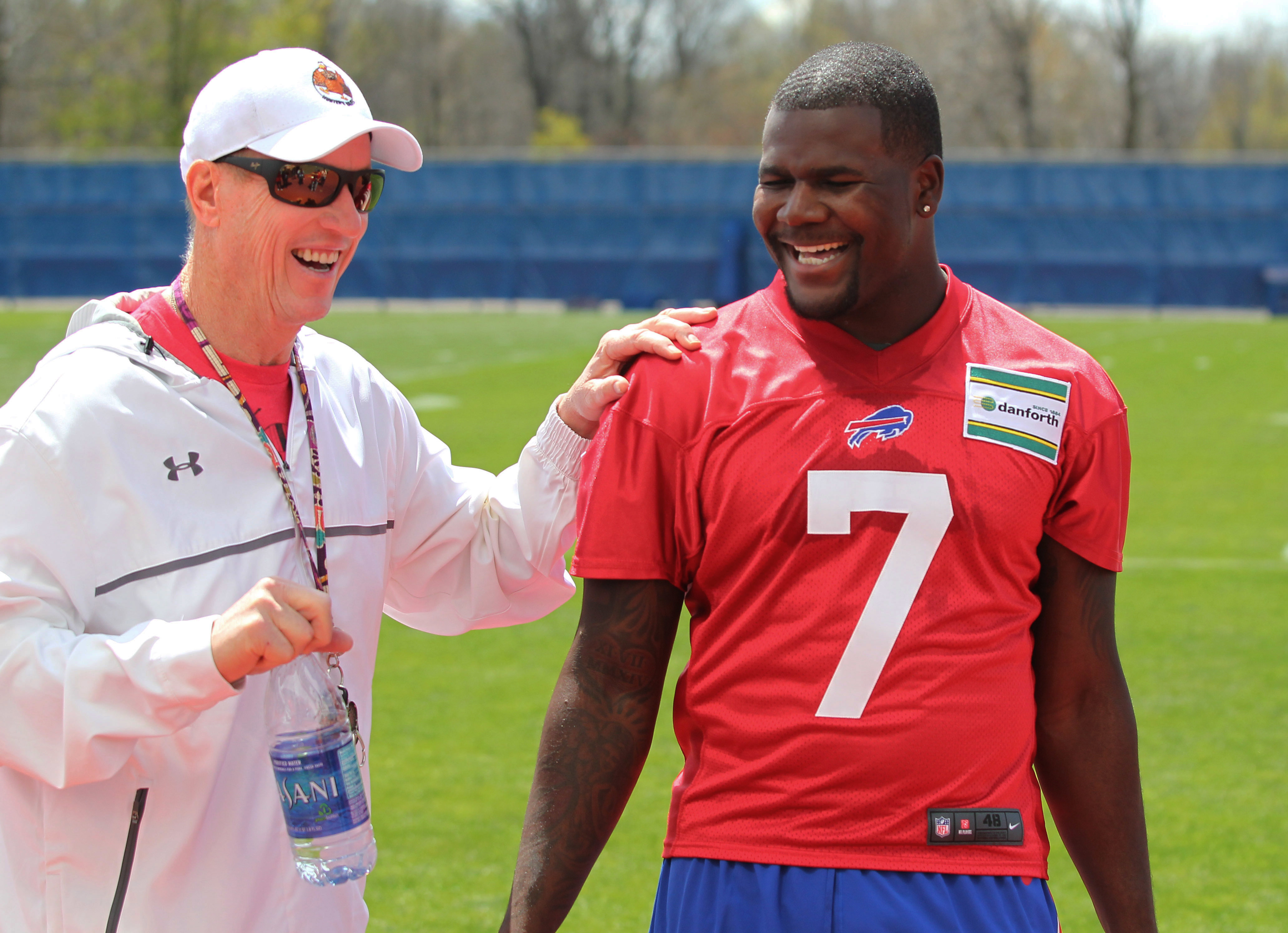 Buffalo Bills quarterback Cardale Jones (7) chats with former Bills quarterback Jim Kelly (L) during their NFL football rookie minicamp in Orchard Park, N.Y., Friday, May 6, 2016. (AP Photo/Bill Wippert)