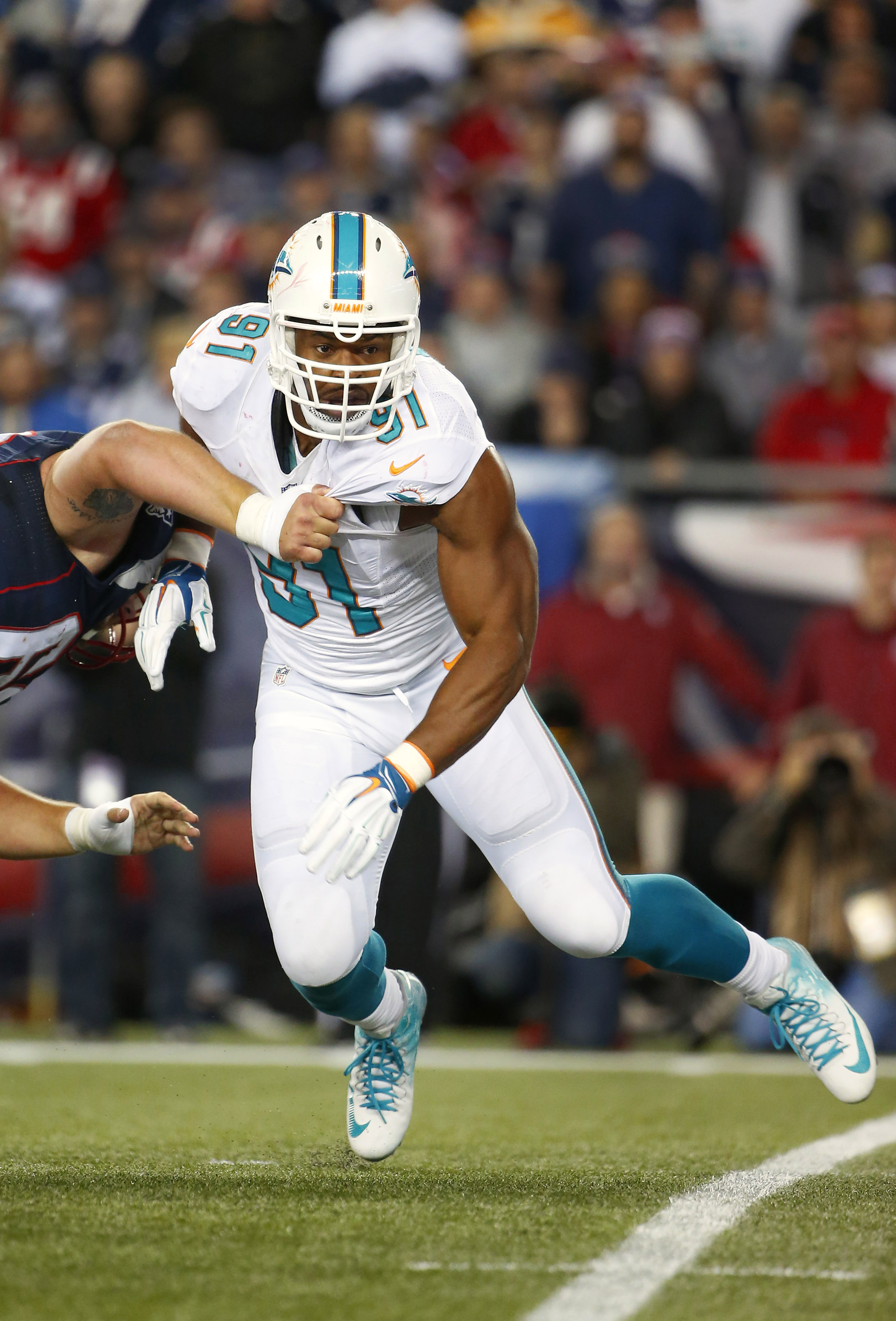 Miami Dolphins defensive end Cameron Wake rushes against the New England Patriots during a NFL football game at Gillette Stadium in Foxborough, Mass. Thursday, Oct. 29, 2015. (Winslow Townson/AP Images for Panini)