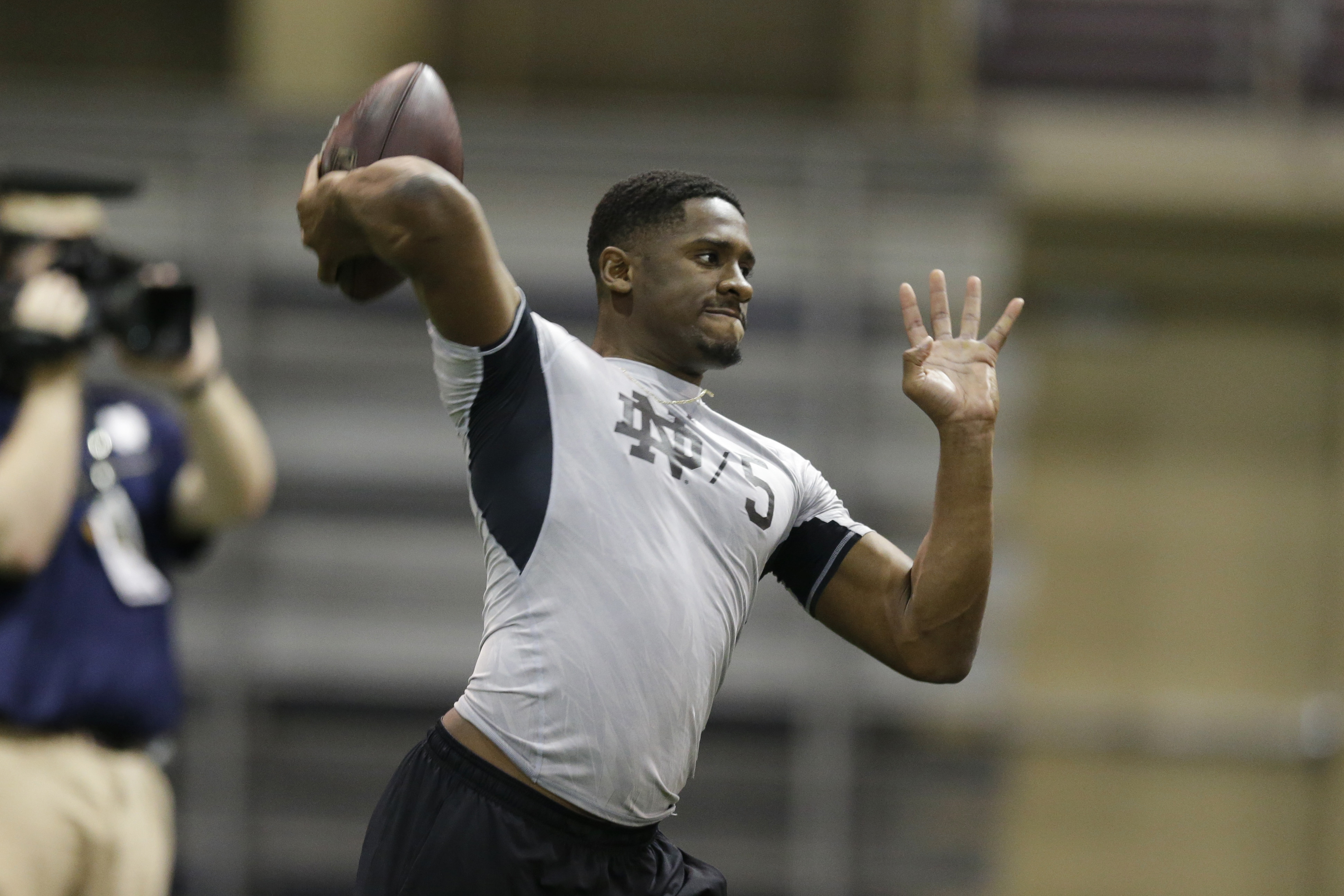 FILE - In this March 31, 2016, file photo, Notre Dame's Everett Golson throws during a drill during Notre Dame's NFL football Pro Day in South Bend, Ind. The former Notre Dame and Florida State quarterback, who wasnt even invited to leagues annual scoutin