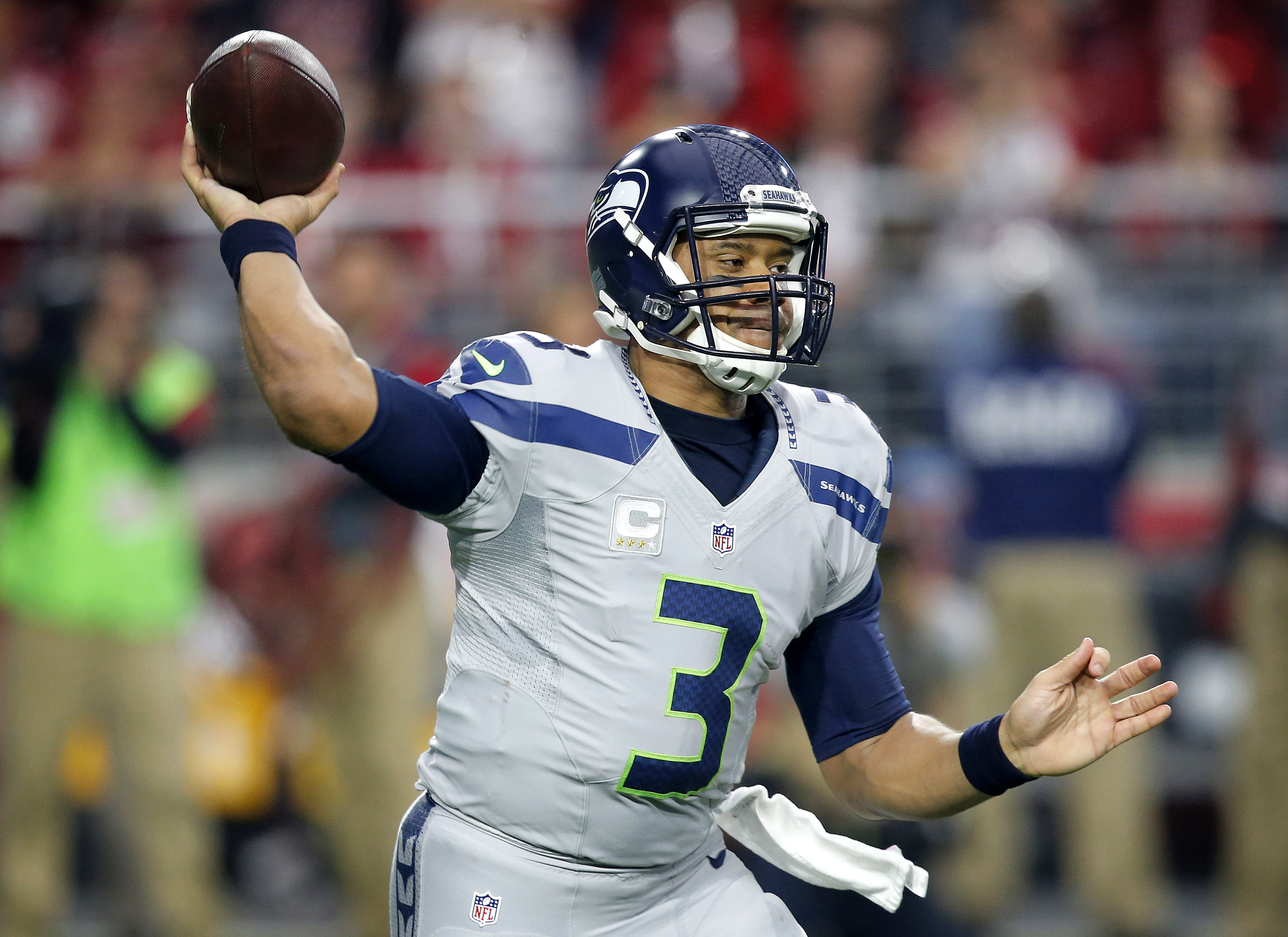 FILE - In this Jan. 3, 2016, file photo, Seattle Seahawks quarterback Russell Wilson (3) throws against the Arizona Cardinals during the first half of an NFL football game in Glendale, Ariz. Invited back to Wisconsin to deliver a graduation address on Sun