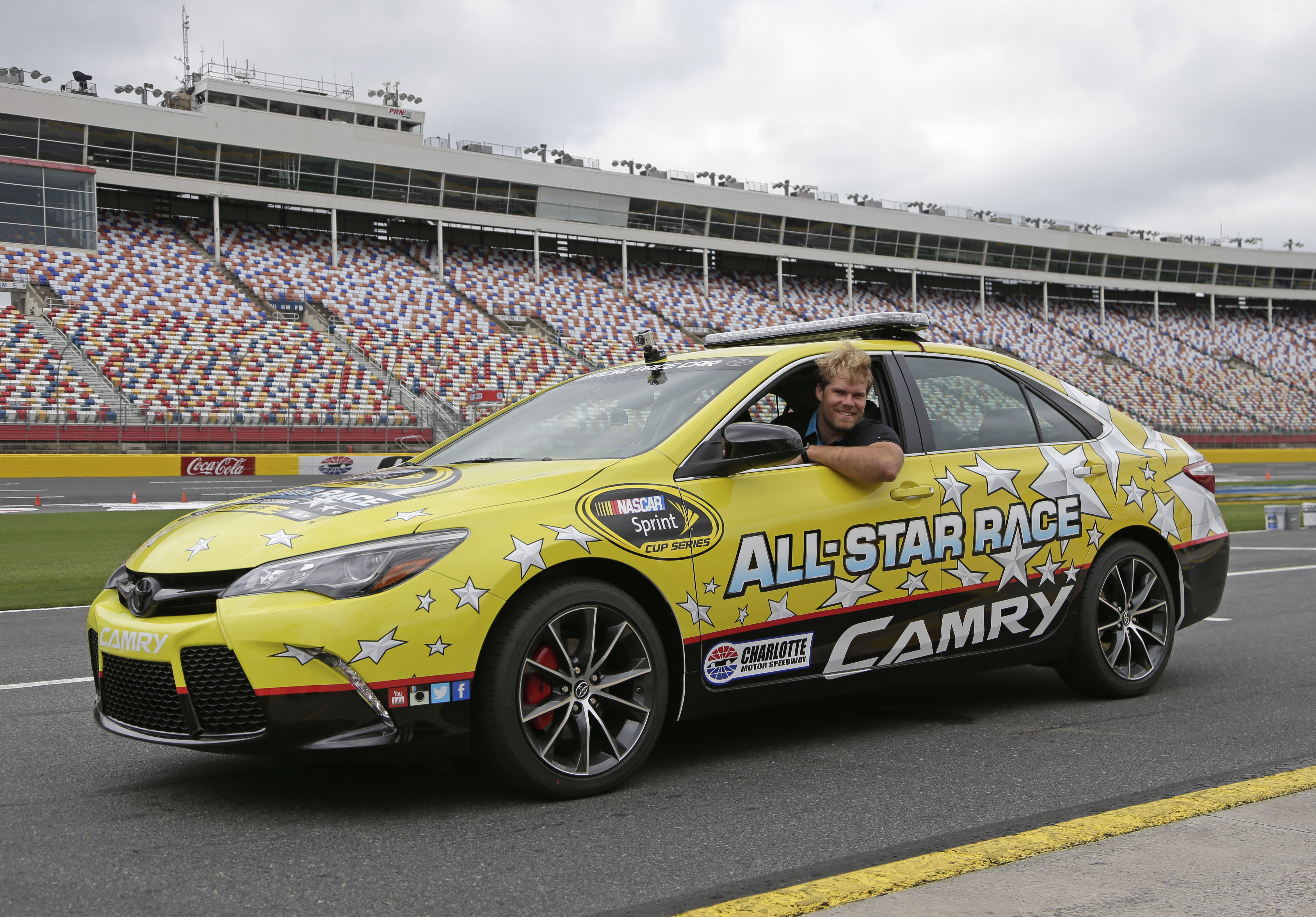 Carolina Panthers' Greg Olsen leans out of the pace car before taking certification laps during a news conference at Charlotte Motor Speedway in Concord, N.C., Wednesday, May 18, 2016. Olsen will lead the field at the start of the NASCAR Sprint Cup series